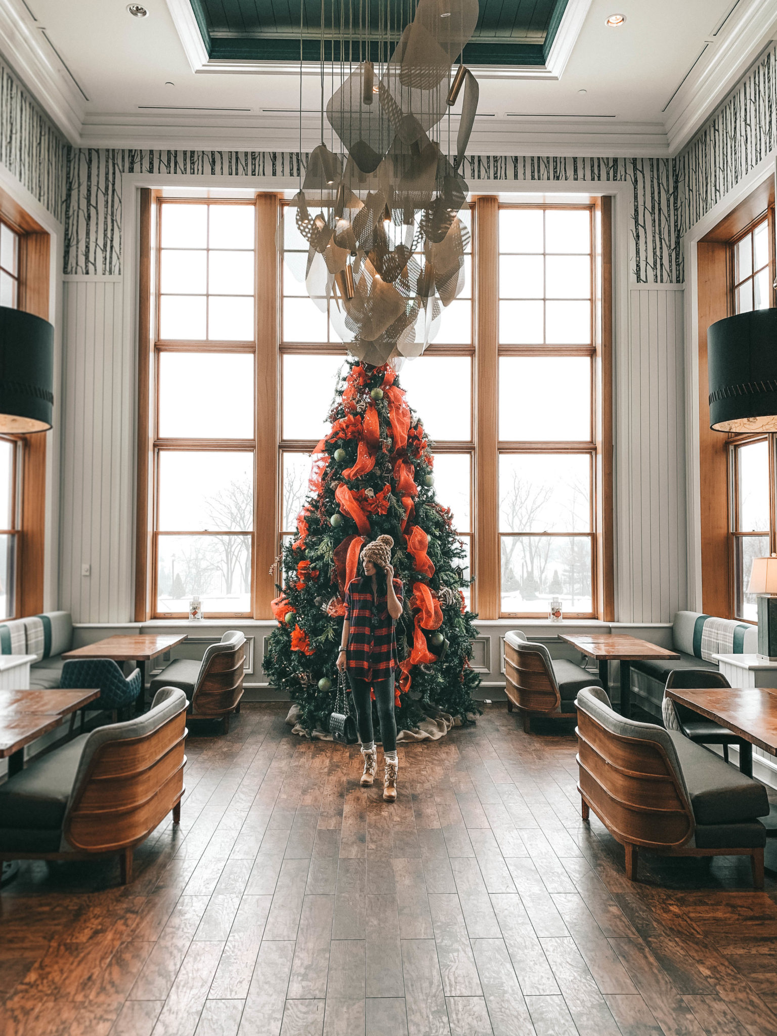 The Rosseau Muskoka featured by top US travel blog Dressed to Kill; Woman in hotel lobby