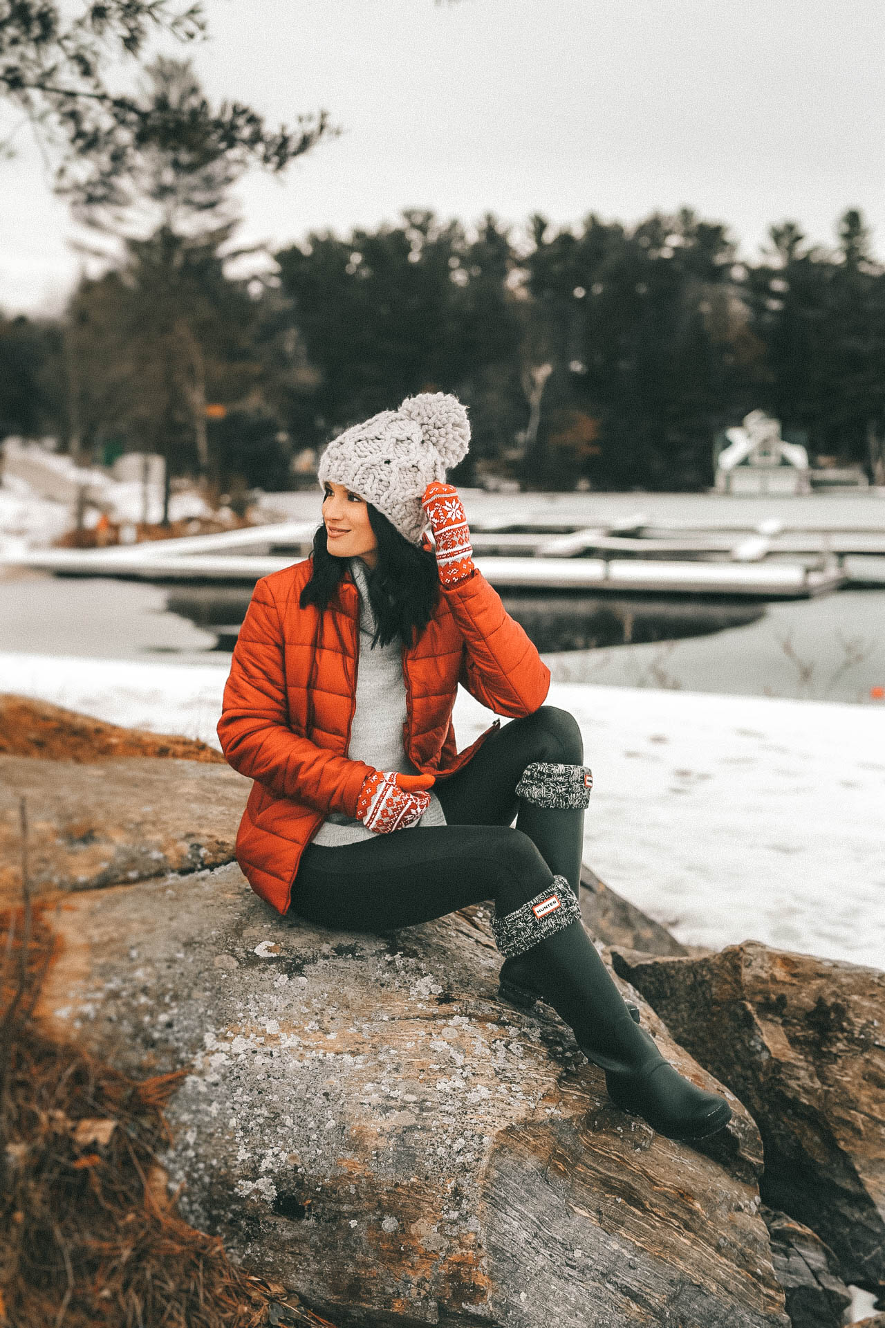 The Rosseau Muskoka featured by top US travel blog Dressed to Kill; Woman sitting on lake shore in Canada