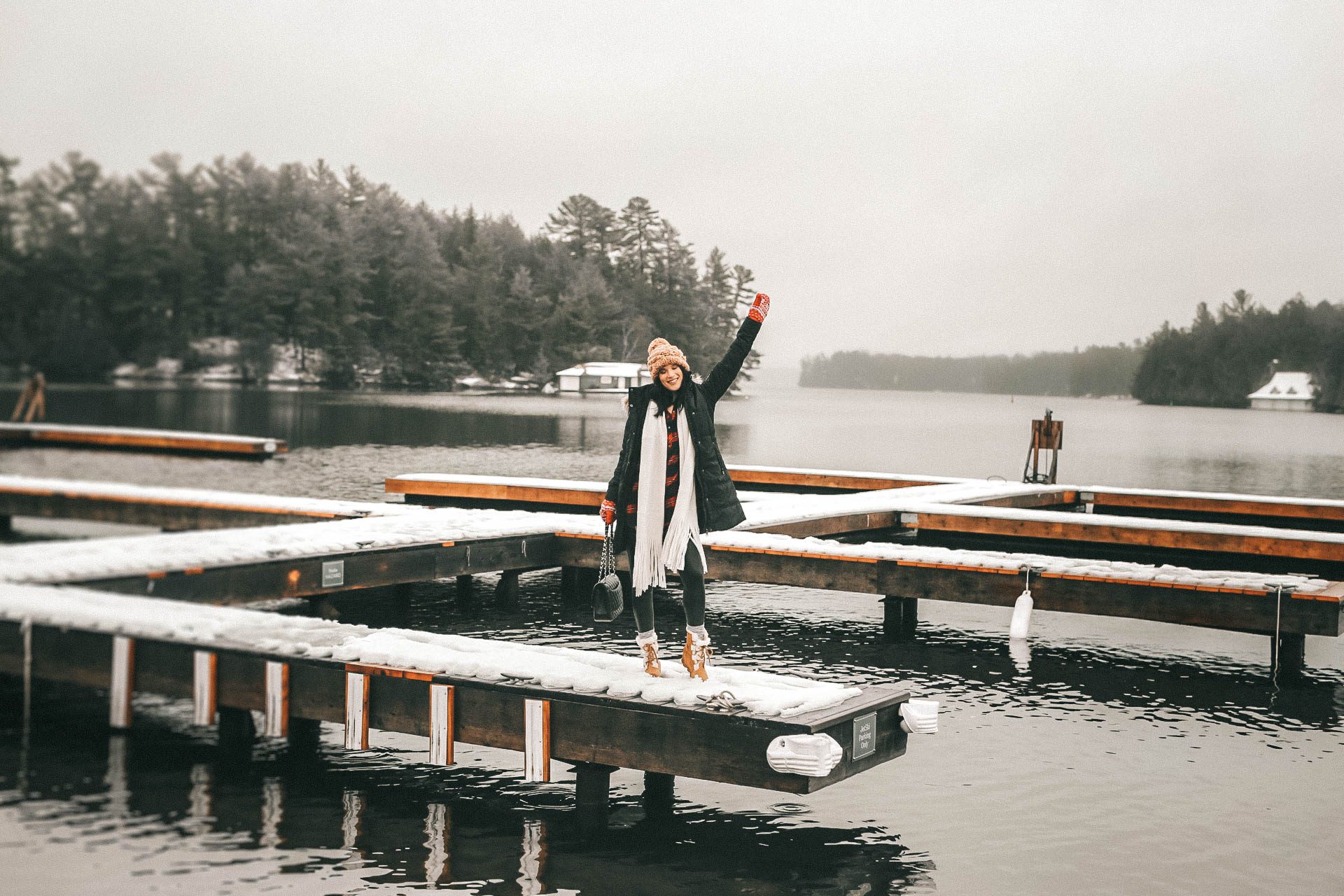 The Rosseau Muskoka featured by top US travel blog Dressed to Kill; Girl standing on dock in Canada