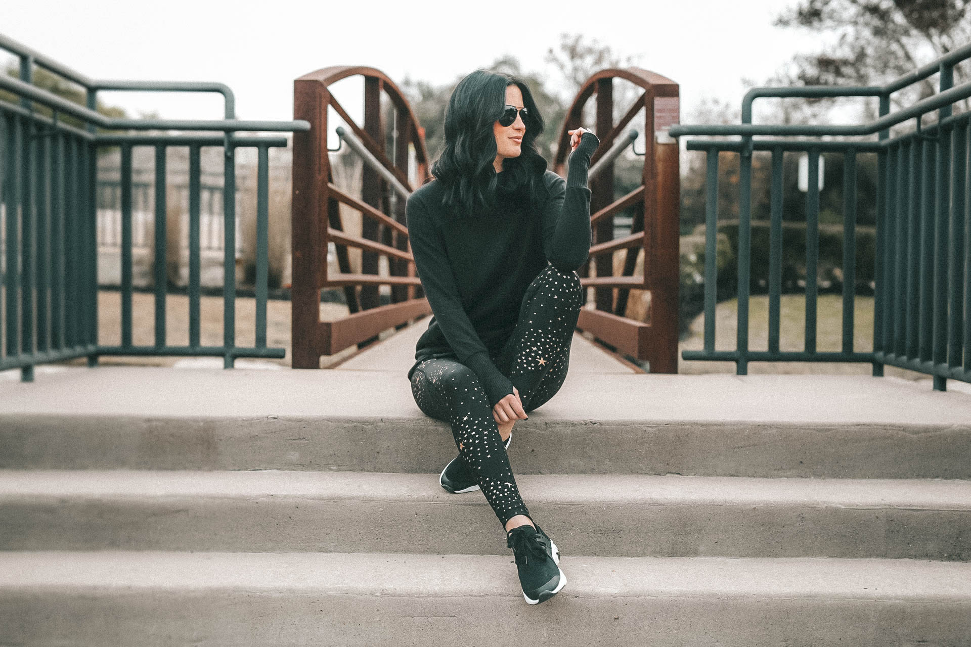 Affordable Activewear featured by top US fashion blog Dressed to Kill; Women wearing Walmart workout legging sitting on steps.