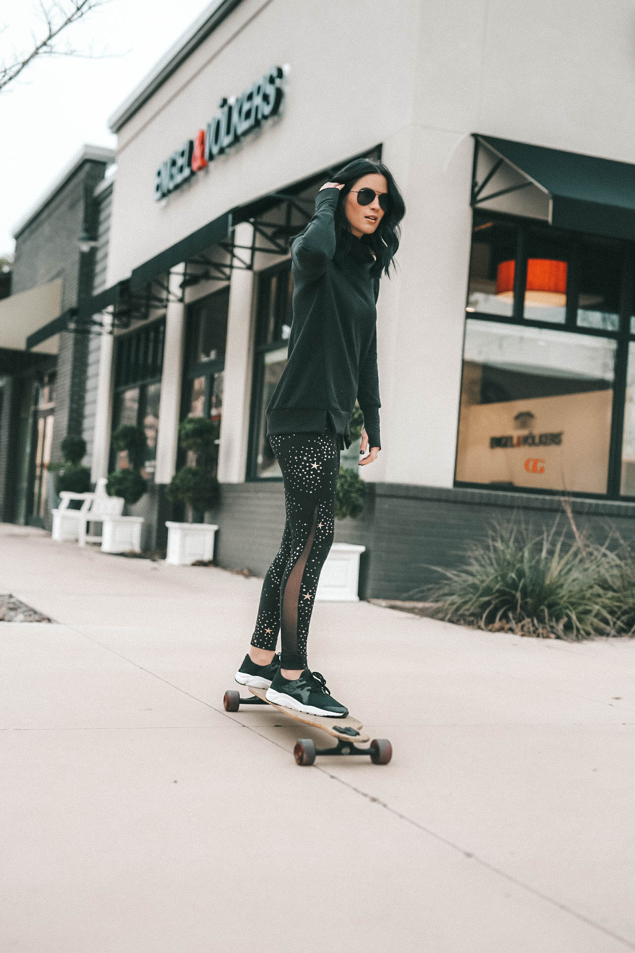 Affordable Activewear featured by top US fashion blog Dressed to Kill; Women wearing Walmart workout legging riding a long board.