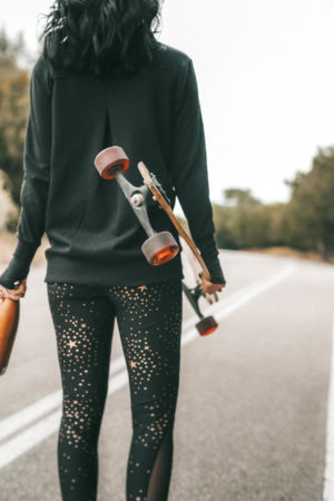 Affordable Activewear featured by top US fashion blog Dressed to Kill; Women wearing Walmart workout legging standing in the road.
