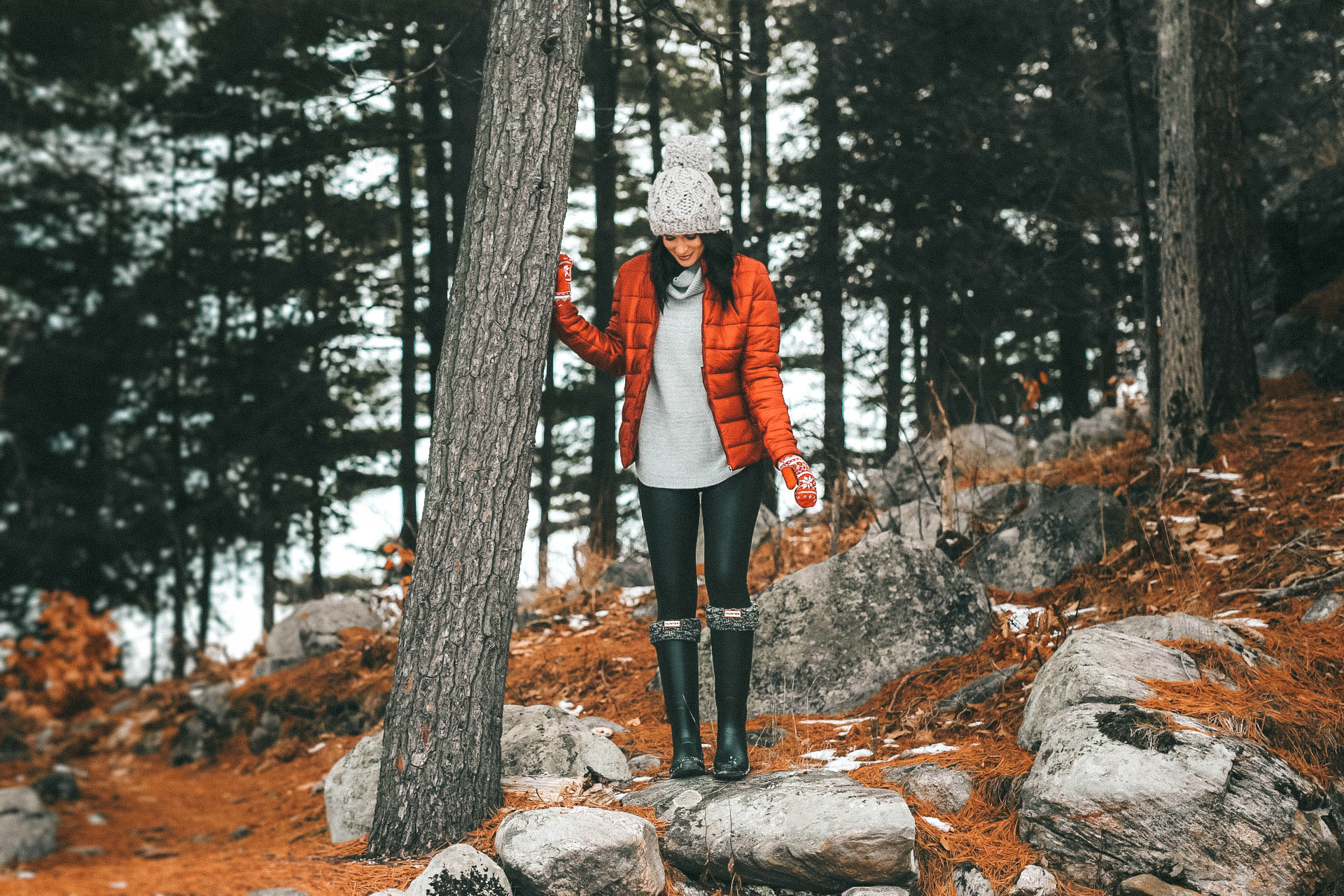 The Rosseau Muskoka featured by top US travel blog Dressed to Kill; Woman standing in woods in Canada