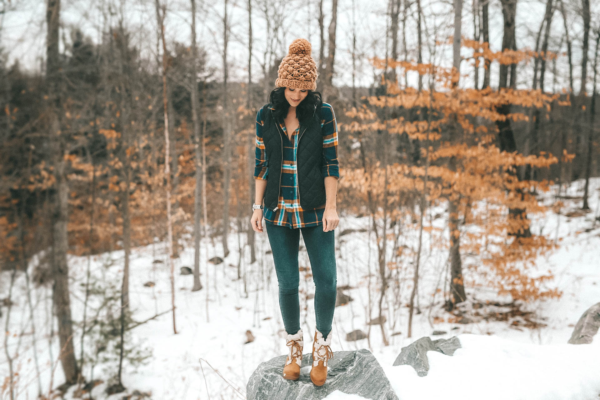 The Rosseau Muskoka featured by top US travel blog Dressed to Kill; Woman standing in the woods
