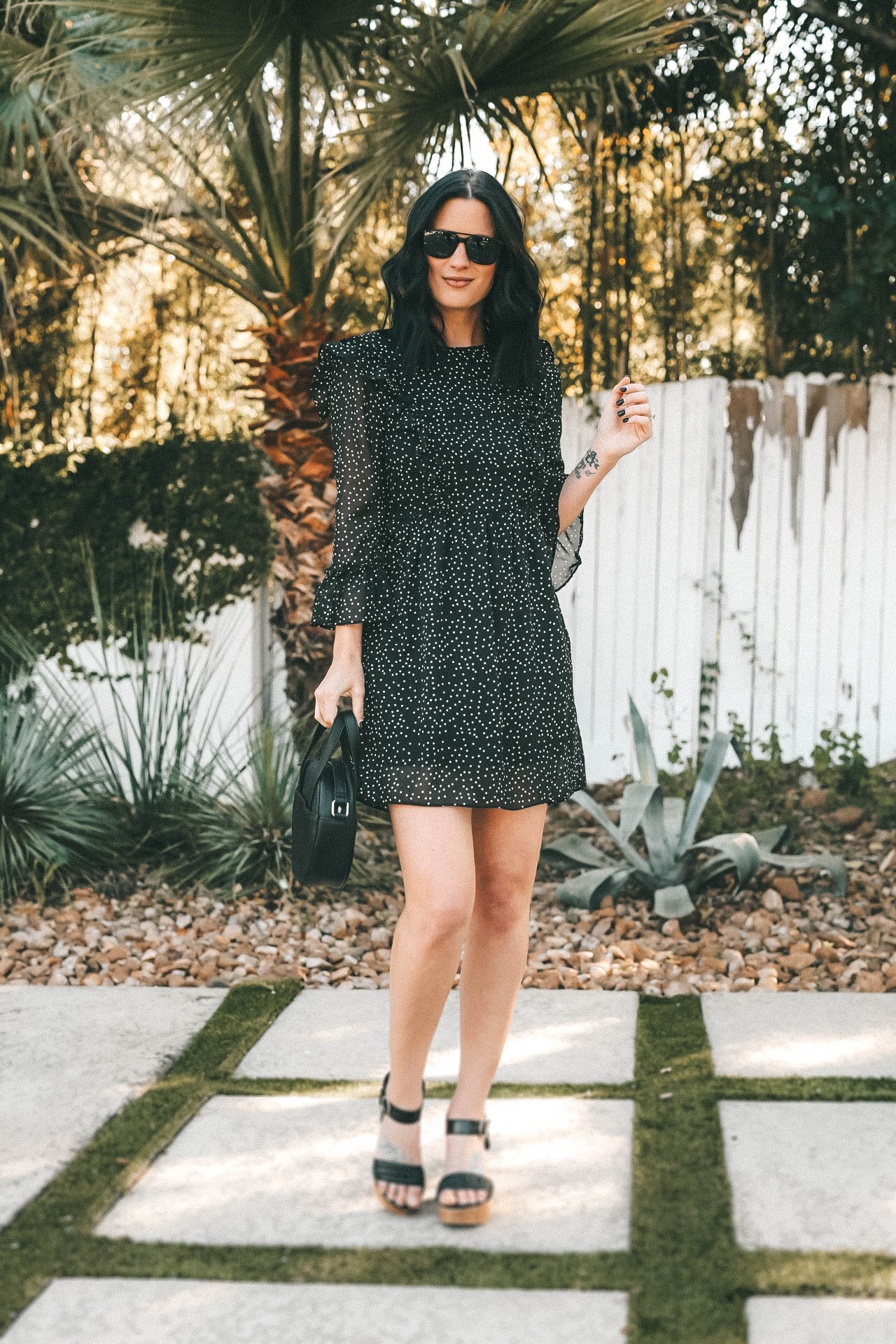 #ad This Polka Dot Dress from @Walmart makes a perfect summer statement! Pair it with a wedge heel, a handbag and sunnies and you're ready for a summer night out! || Dressed to Kill #sponsored #WeDressAmerica #WalmartFashion #summerstyle | We Dress America Walmart campaign featured by top US fashion blog, Dressed to Kill: image of a woman wearing a Walmart polka dot mini dress, Walmart crossbody circle bag, and Walmart wedge sandals
