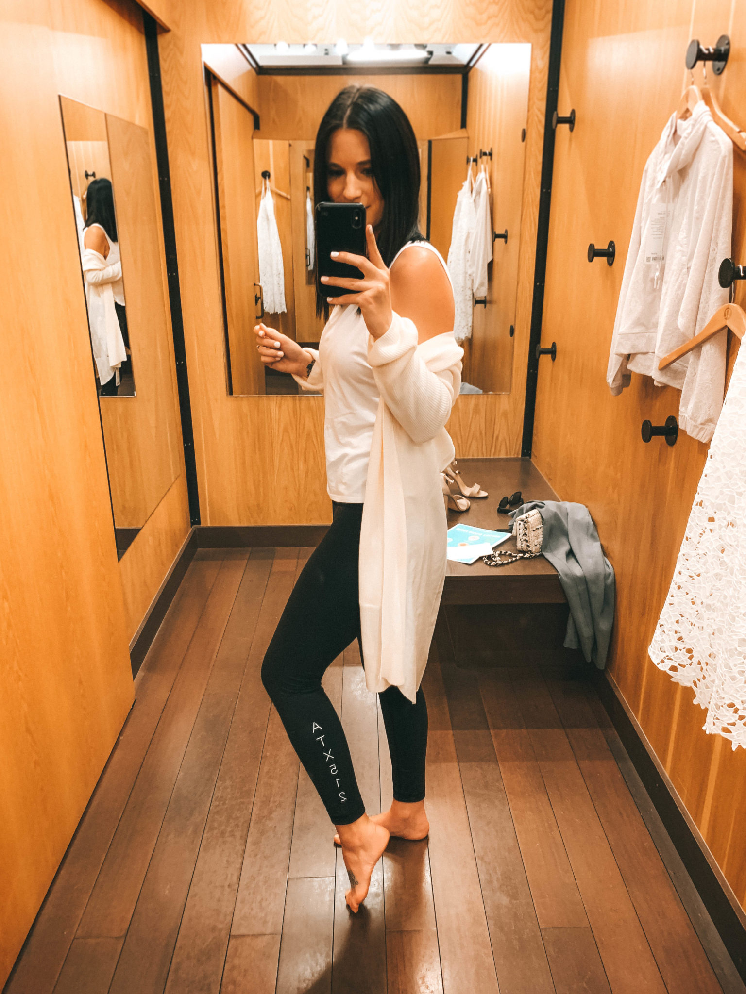 Unique Mother's Day Gift Ideas featured by top US life and style blogger Dressed to Kill; Image of a woman wearing black leggings and white tank.