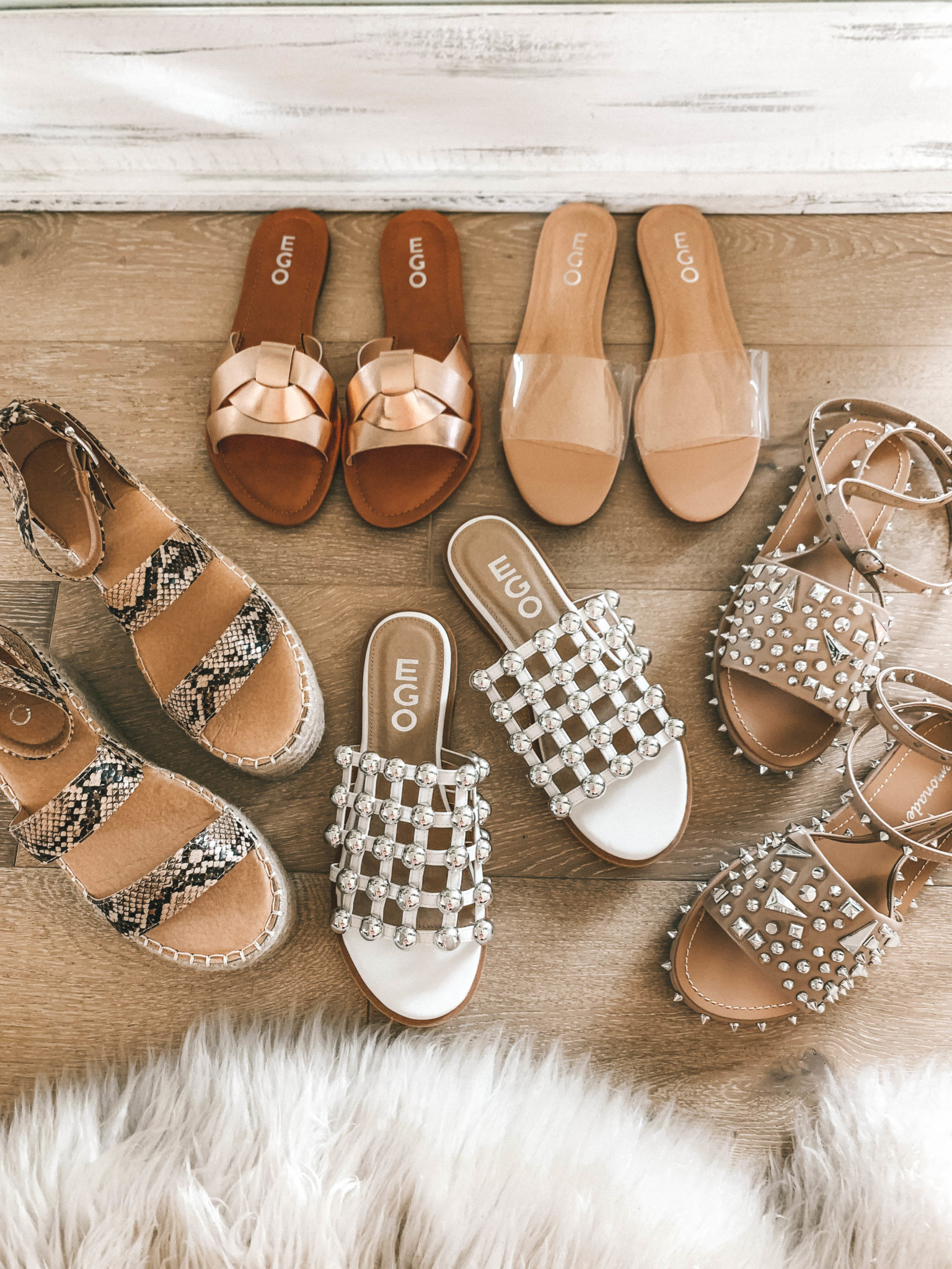 5 Must Have Affordable EGO Sandals for Summer by popular Austin fashion blog, Dressed to Kill: image of 5 pairs of EGO sandals grouped together on a wood floor.