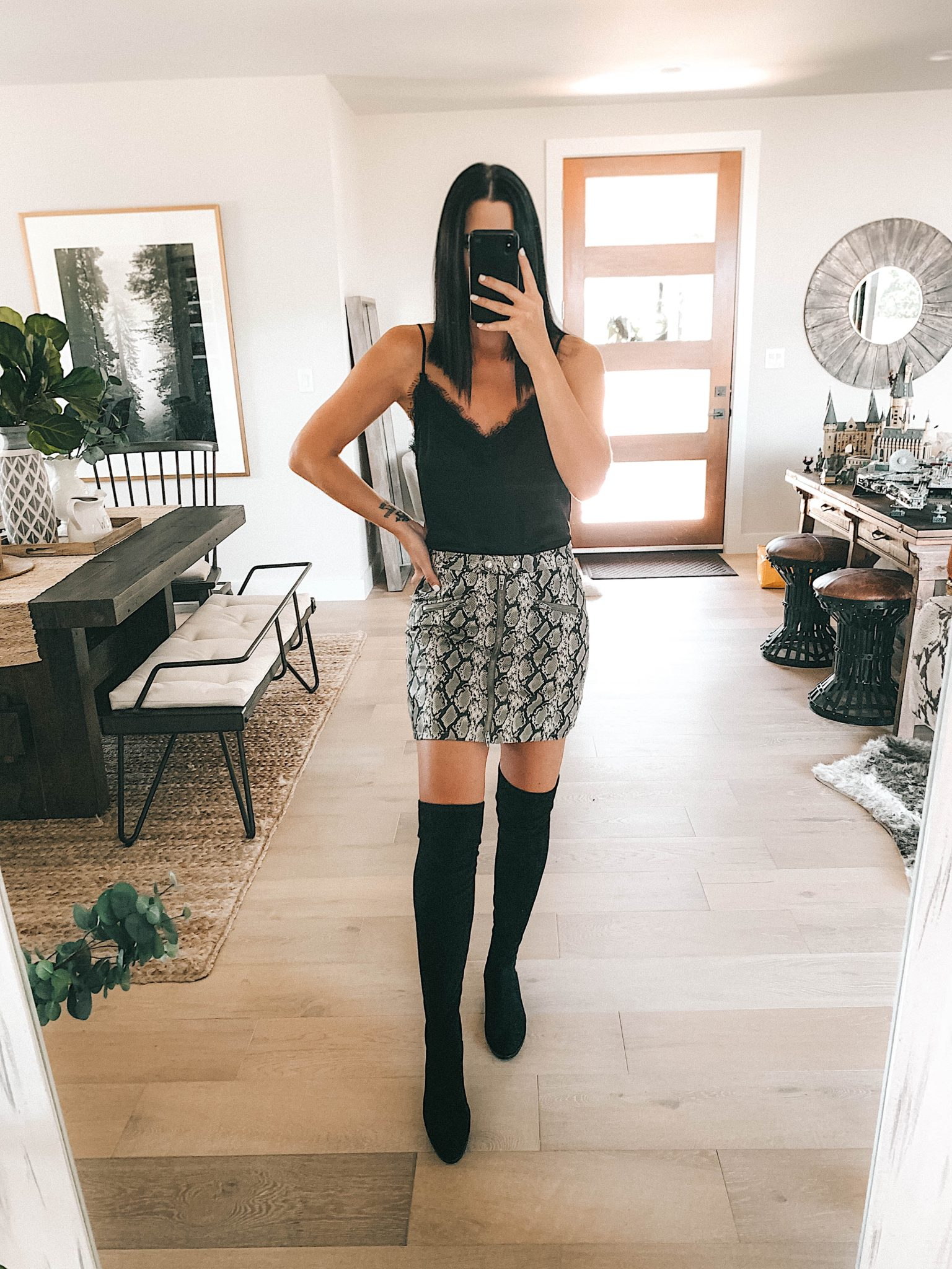 Create a Capsule Wardrobe with Nordstrom Anniversary Sale Pieces by popular Austin fashion blog, Dressed to Kill: image of a woman standing in her house and wearing a Nordstrom BlankNYC Snakeskin Mini Skirt, Steve Madden Over the Knee Boots and BP Lace Cami.