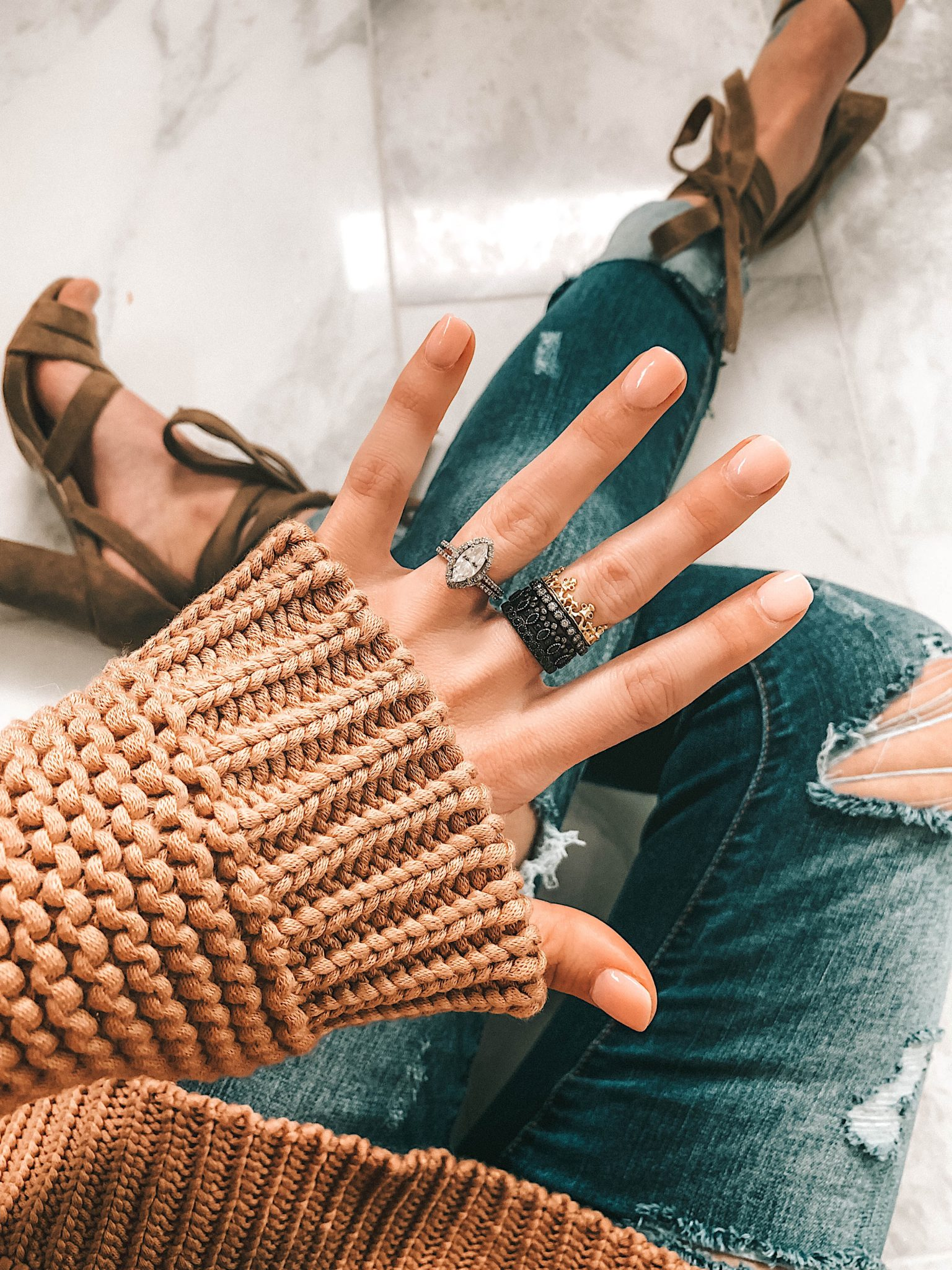 How to Wear Armenta Stackable Rings by popular Austin fashion blog, Dressed to Kill: image a woman's hand with and Armenta stackable ring set on it.