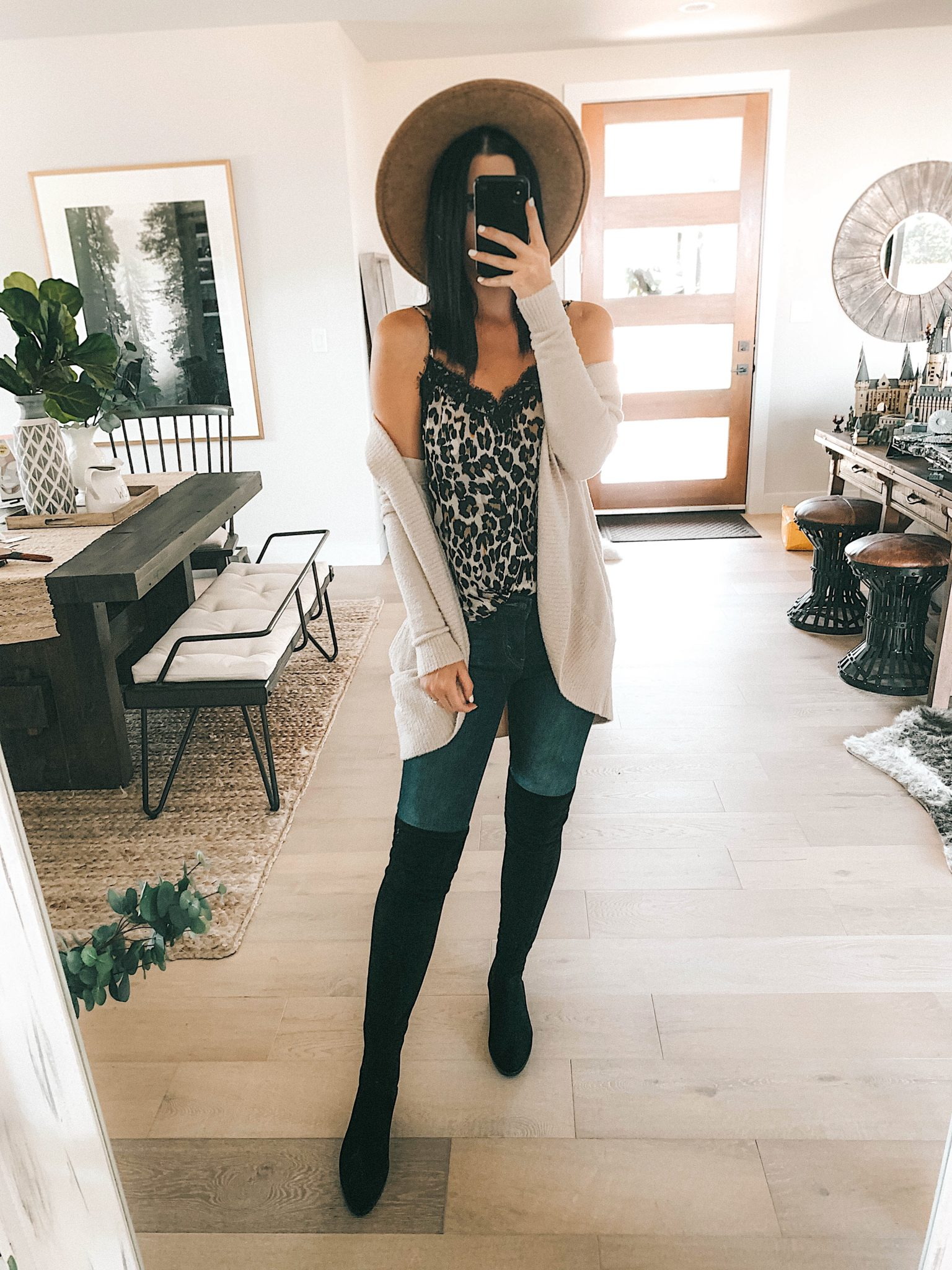 Create a Capsule Wardrobe with Nordstrom Anniversary Sale Pieces by popular Austin fashion blog, Dressed to Kill: image of a woman standing in her house and wearing a Nordstrom Free People Oversized Tunic and Steve Madden Over the Knee Boots
