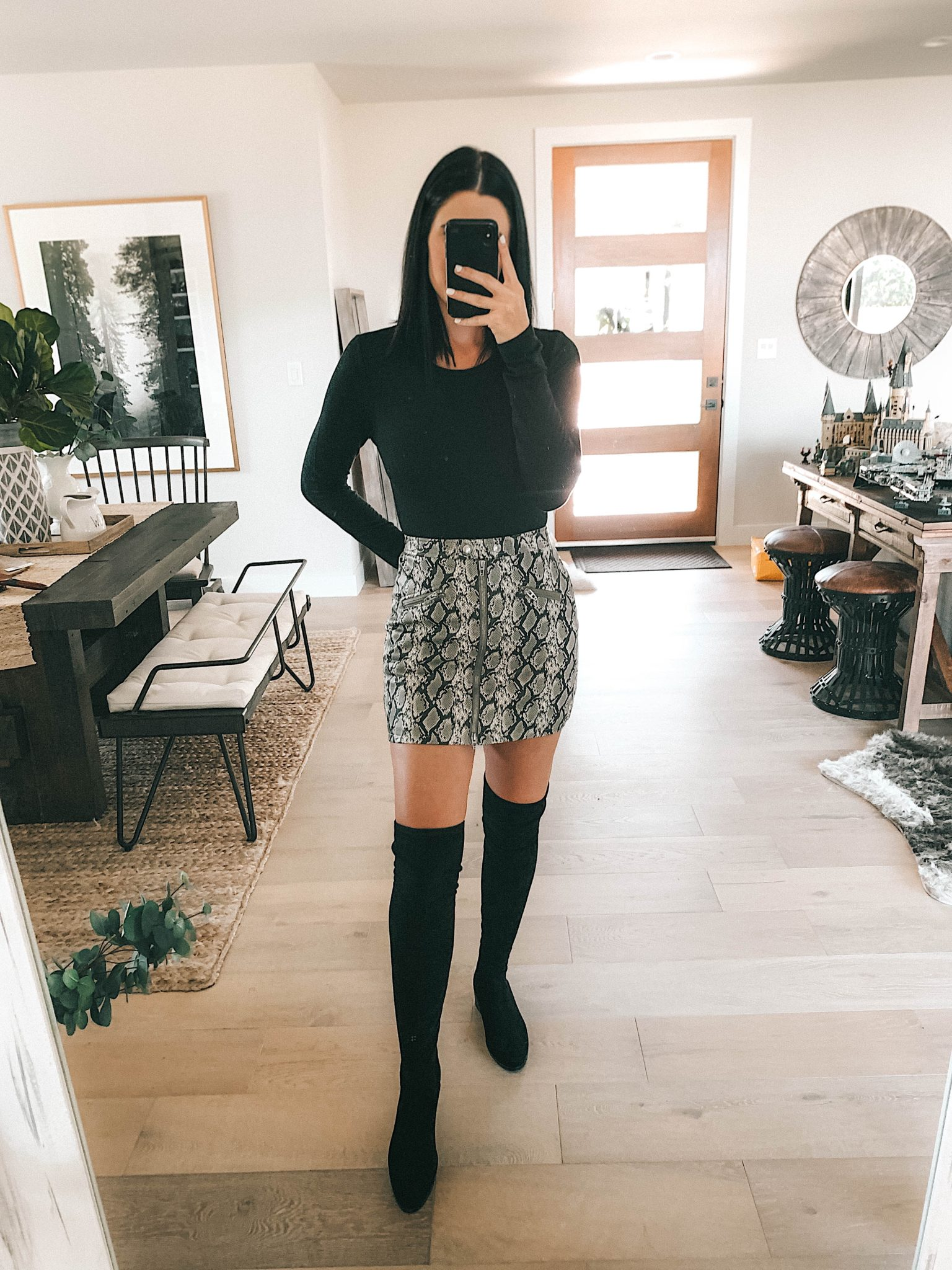 Create a Capsule Wardrobe with Nordstrom Anniversary Sale Pieces by popular Austin fashion blog, Dressed to Kill: image of a woman standing in her house and wearing a Nordstrom Signature Cashmere Sweater, BlankNYC Snakeskin Mini Skirt and Steve Madden Over the Knee Boots.