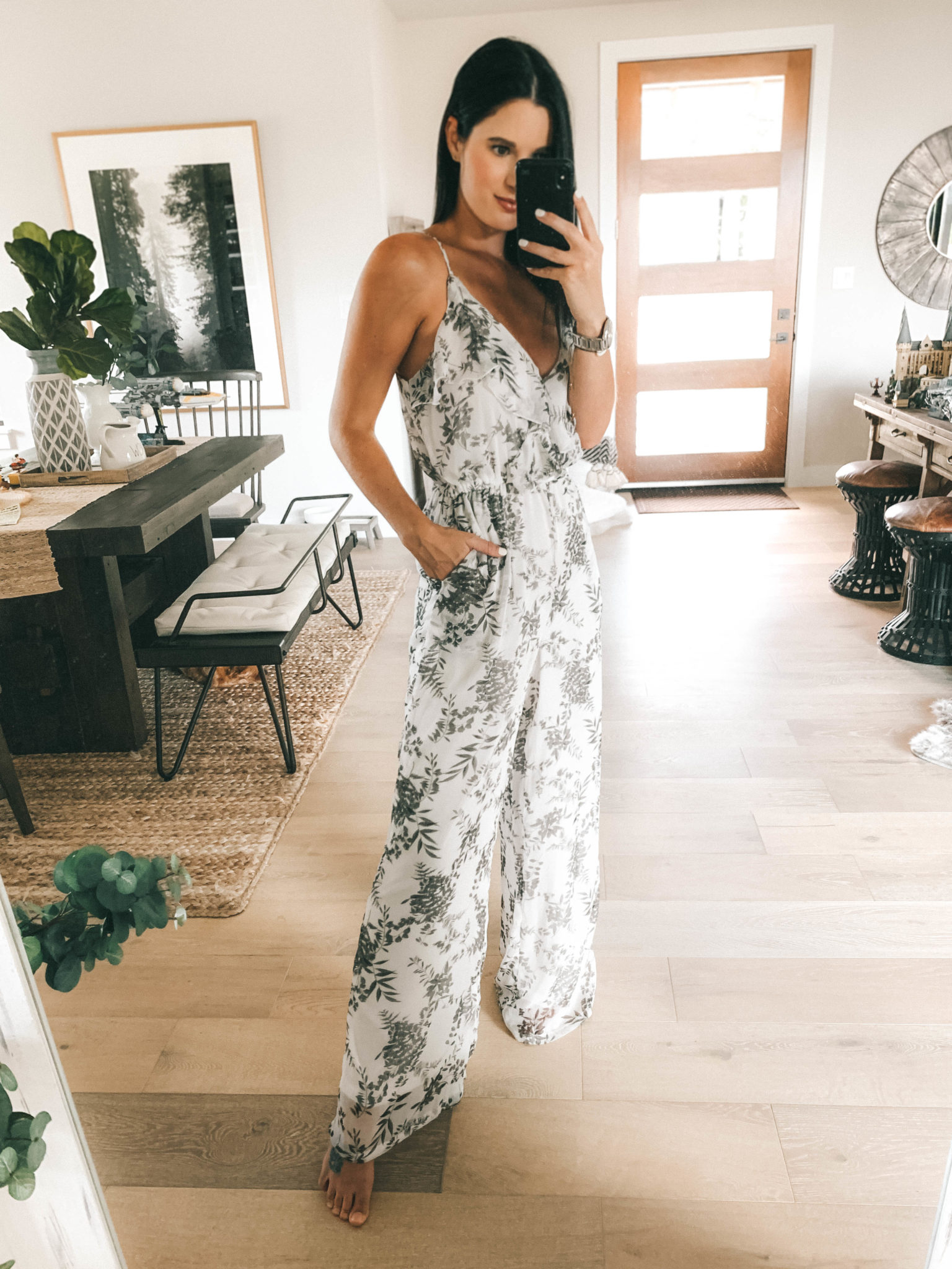 Amaryllis Apparel Abroad Turks & Caicos Summer Try-On by popular Austin fashion blog, Dressed to Kill: image of a woman wearing an Amaryllis Apparel Garden Noir Jumpsuit.