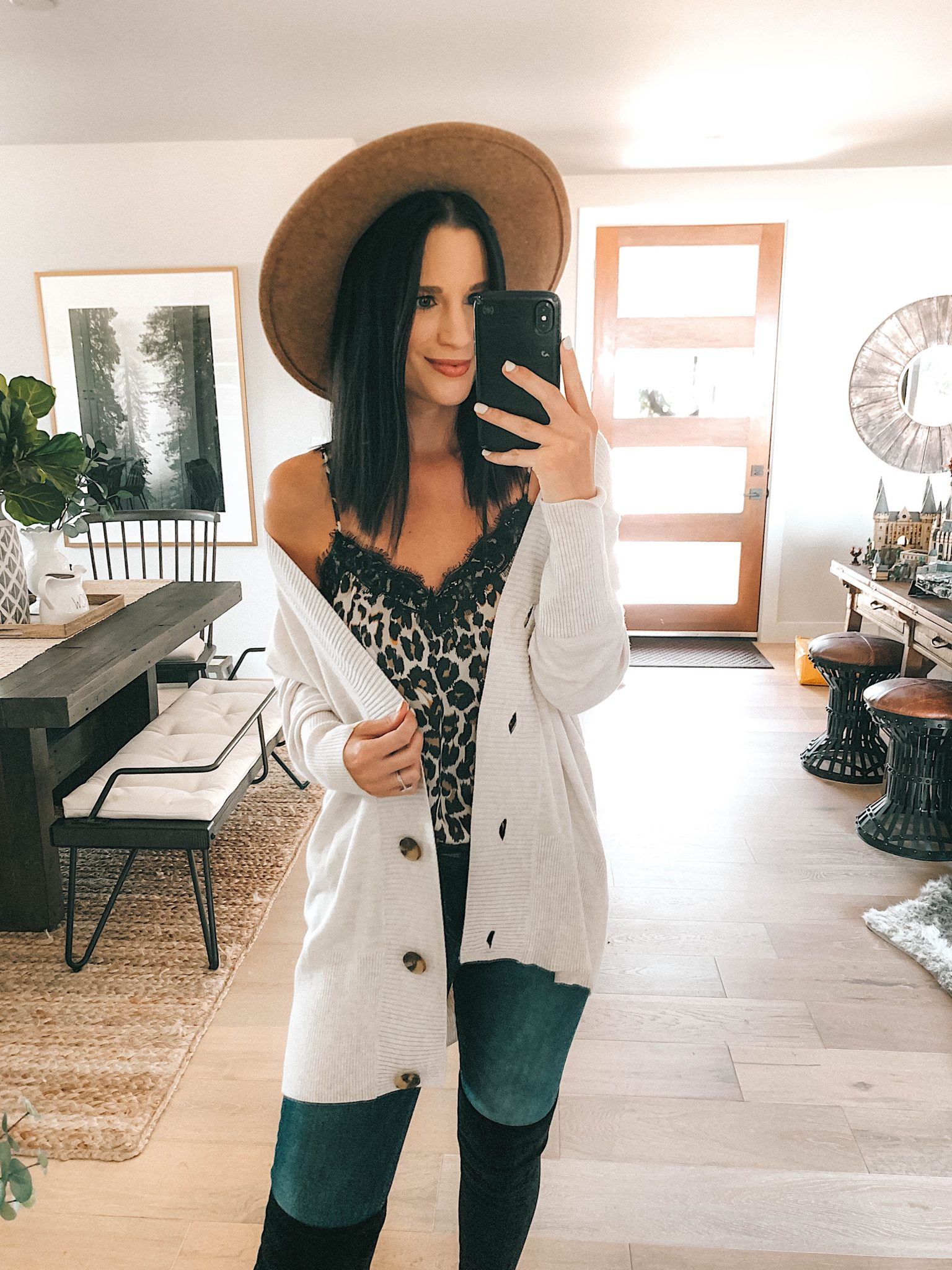 Create a Capsule Wardrobe with Nordstrom Anniversary Sale Pieces by popular Austin fashion blog, Dressed to Kill: image of a woman standing in her house and wearing a Chelsea28 Button Front Cardigan and Steve Madden Over the Knee Boots