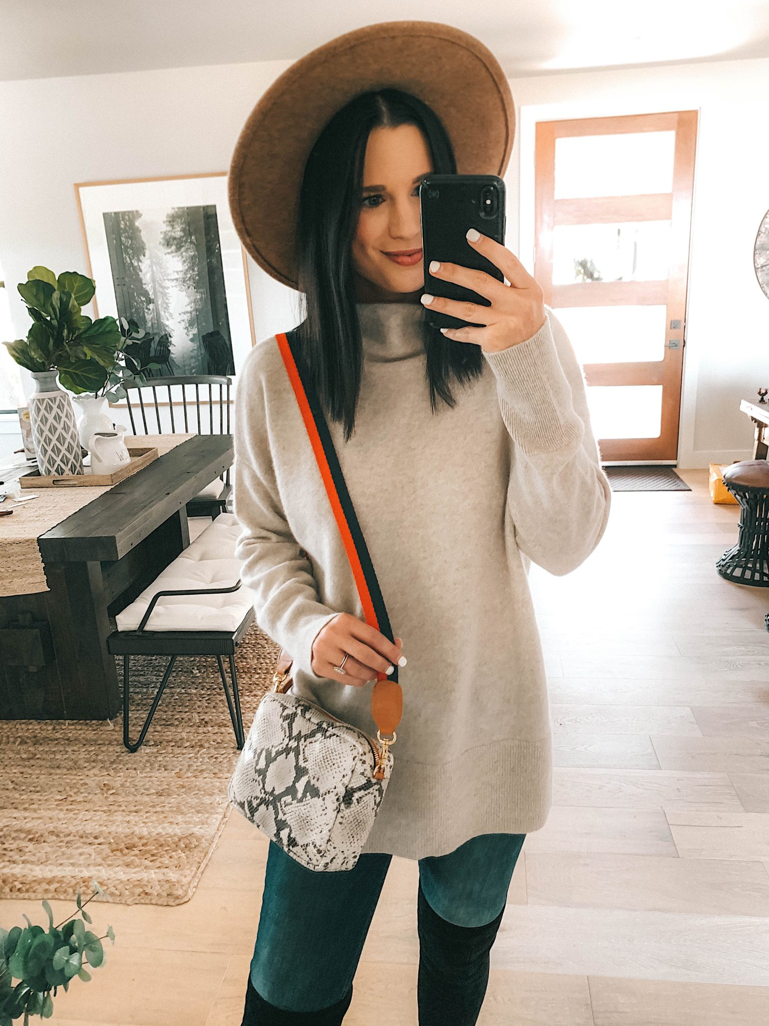Create a Capsule Wardrobe with Nordstrom Anniversary Sale Pieces by popular Austin fashion blog, Dressed to Kill: image of a woman standing in her house and wearing a Nordstrom Signature Cashmere Sweater and Steve Madden Over the Knee Boots.