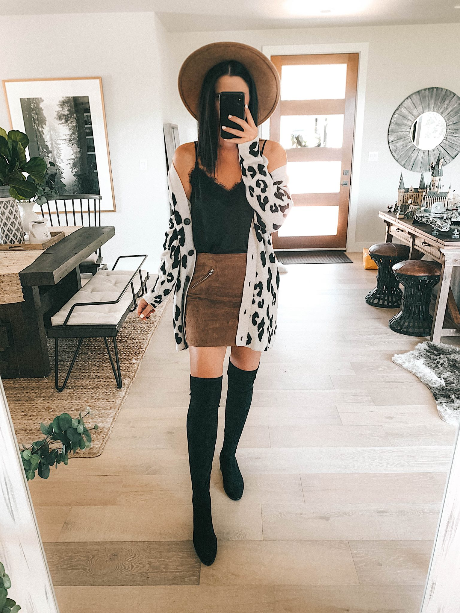 how to create a capsule wardrobe with picks from the Nordstrom Anniversary Sale. by popular Austin fashion blog, Dressed to Kill: image of a woman standing in her house and wearing a Nordstrom BlankNYC Snakeskin Mini Skirt, leopard print cardigan, Steve Madden Over the Knee Boots and BP Lace Cami