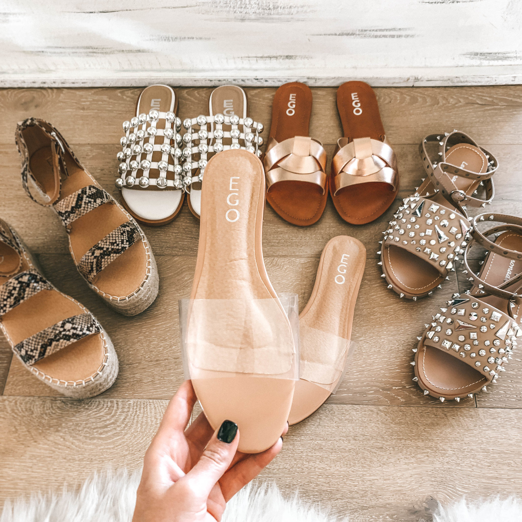 5 Must Have Affordable EGO Sandals for Summer by popular Austin fashion blog, Dressed to Kill: image of woman holding EGO sandals Kerrie Perspex Sandal In Nude Patent.
