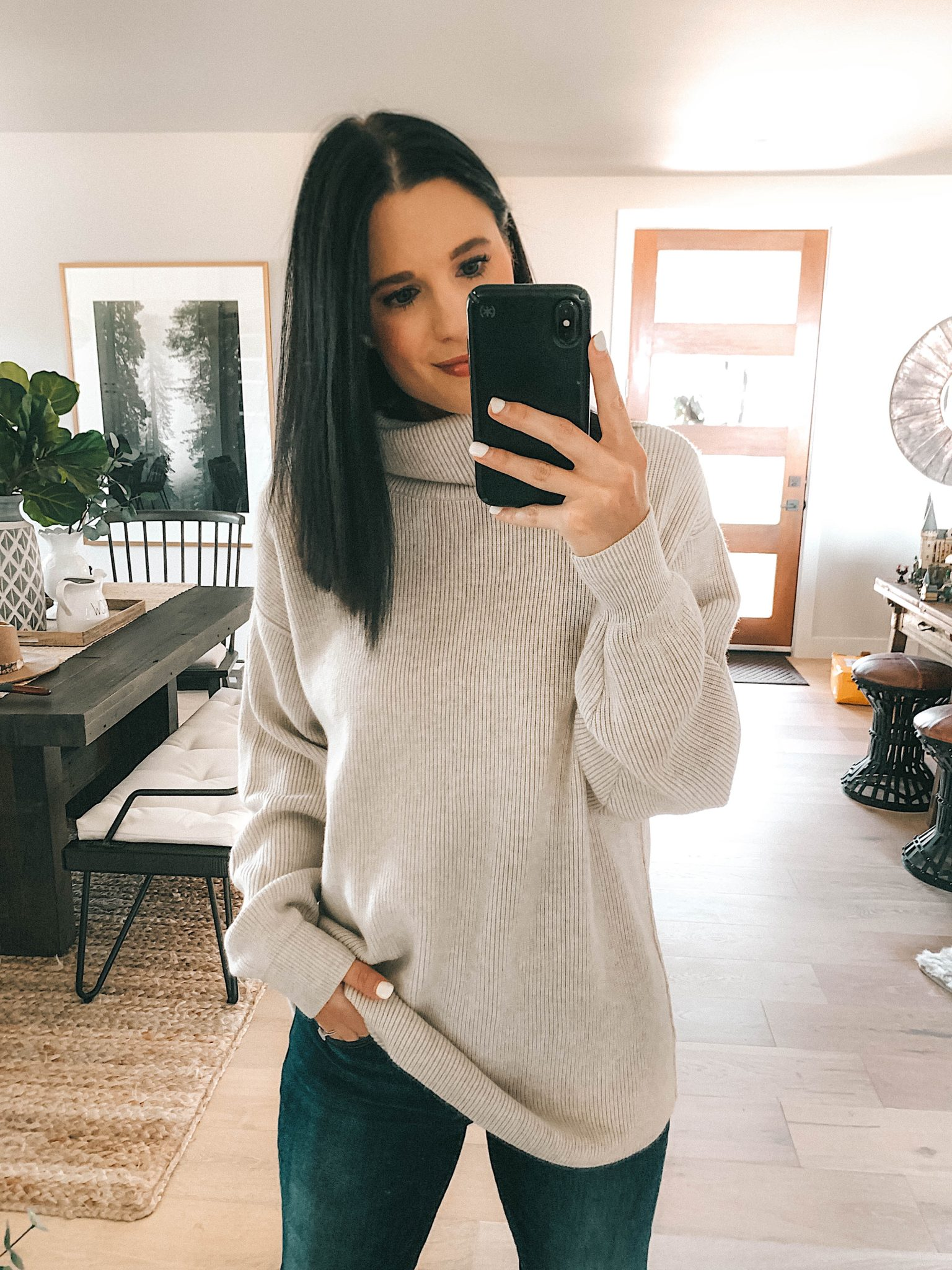 Create a Capsule Wardrobe with Nordstrom Anniversary Sale Pieces by popular Austin fashion blog, Dressed to Kill: image of a woman standing in her house and wearing a Nordstrom Topshop Colorblock Sweater
