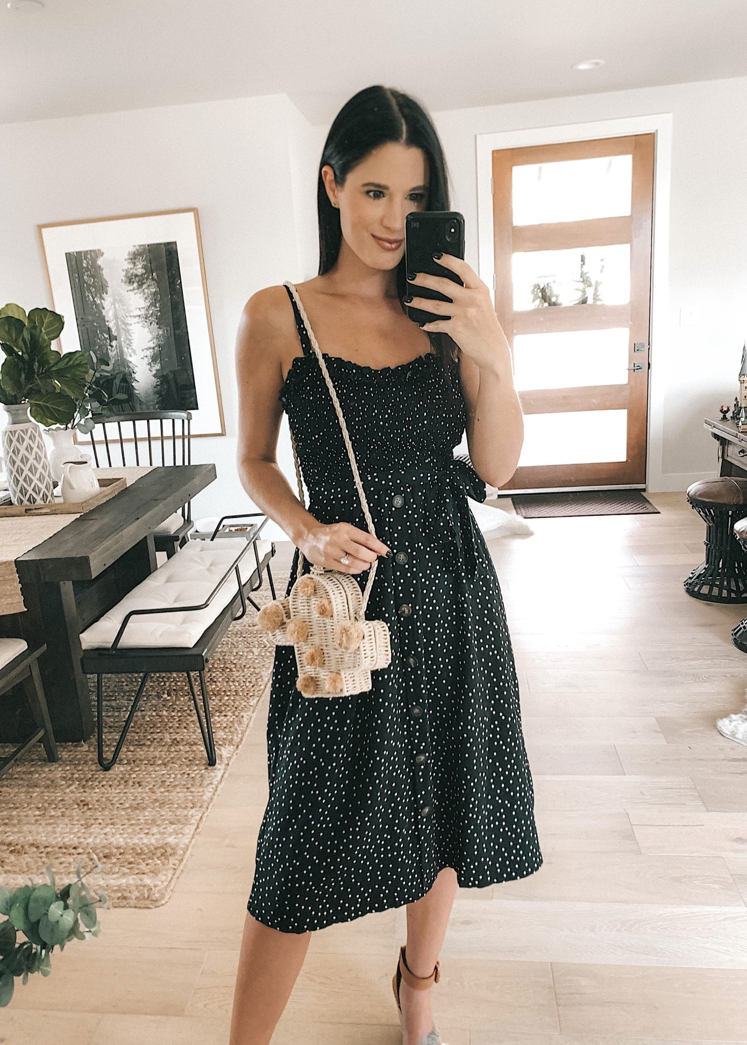 Goodnight Macaroon Summer Dresses Try-On by popular Austin fashion blog, Dressed to Kill: image of a woman standing in her house and wearing a Goodnight Macaroon 'EAVAN' Polka Dot Tie Waist Midi Dress.