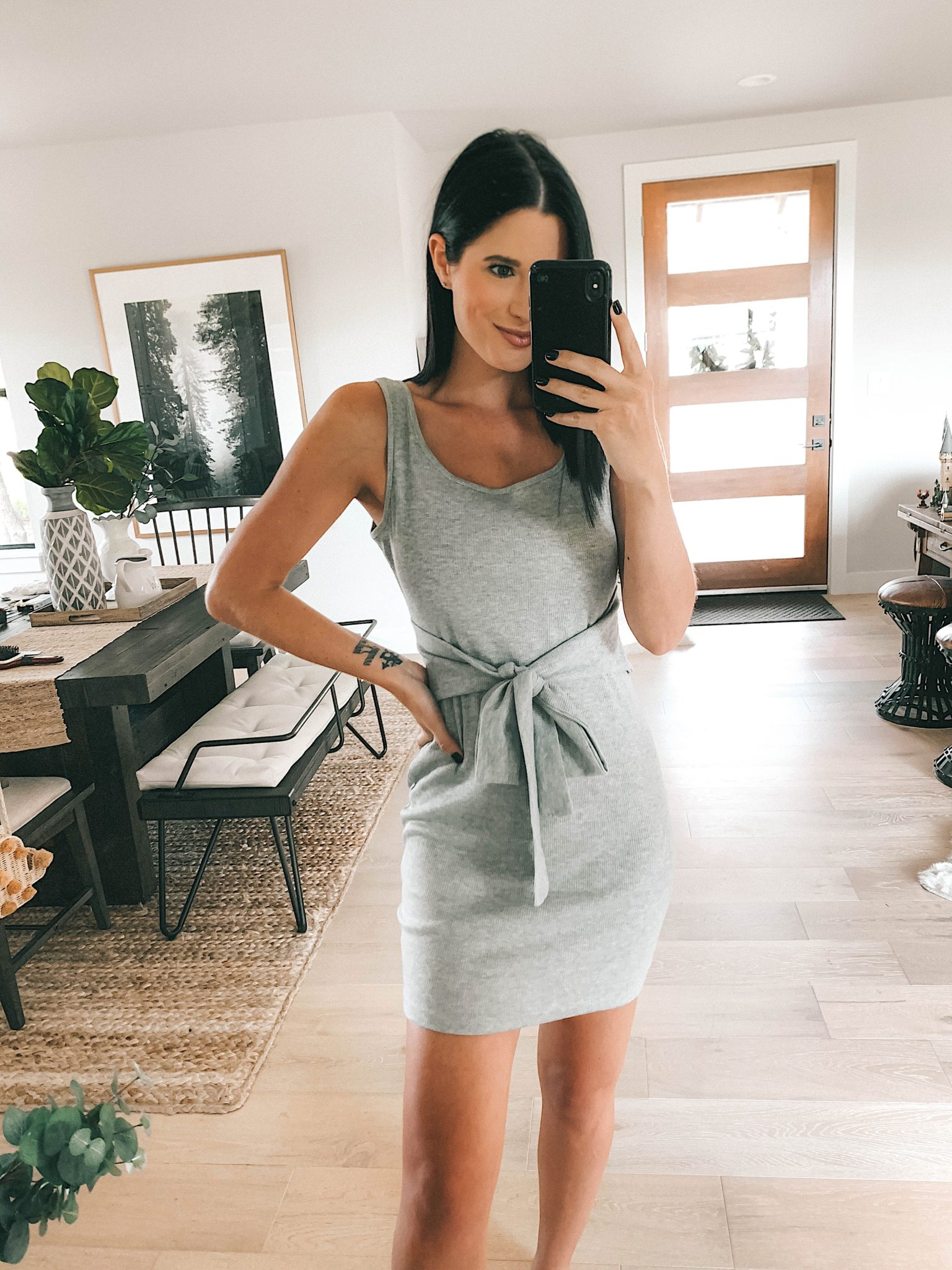 Goodnight Macaroon Summer Dresses Try-On by popular Austin fashion blog, Dressed to Kill: image of a woman standing in her house and wearing a 'Tabby' Tie Waist Knitted Tank Mini Dress.