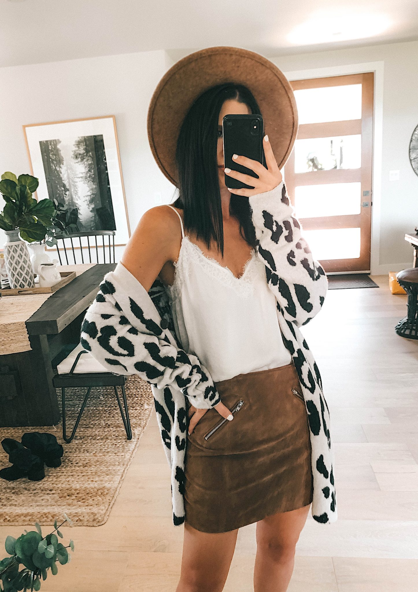 Create a Capsule Wardrobe with Nordstrom Anniversary Sale Pieces by popular Austin fashion blog, Dressed to Kill: image of a woman standing in her house and wearing a Nordstrom BlankNYC Suede Mini Skirt, Steve Madden Over the Knee Boots and BP Lace Cami