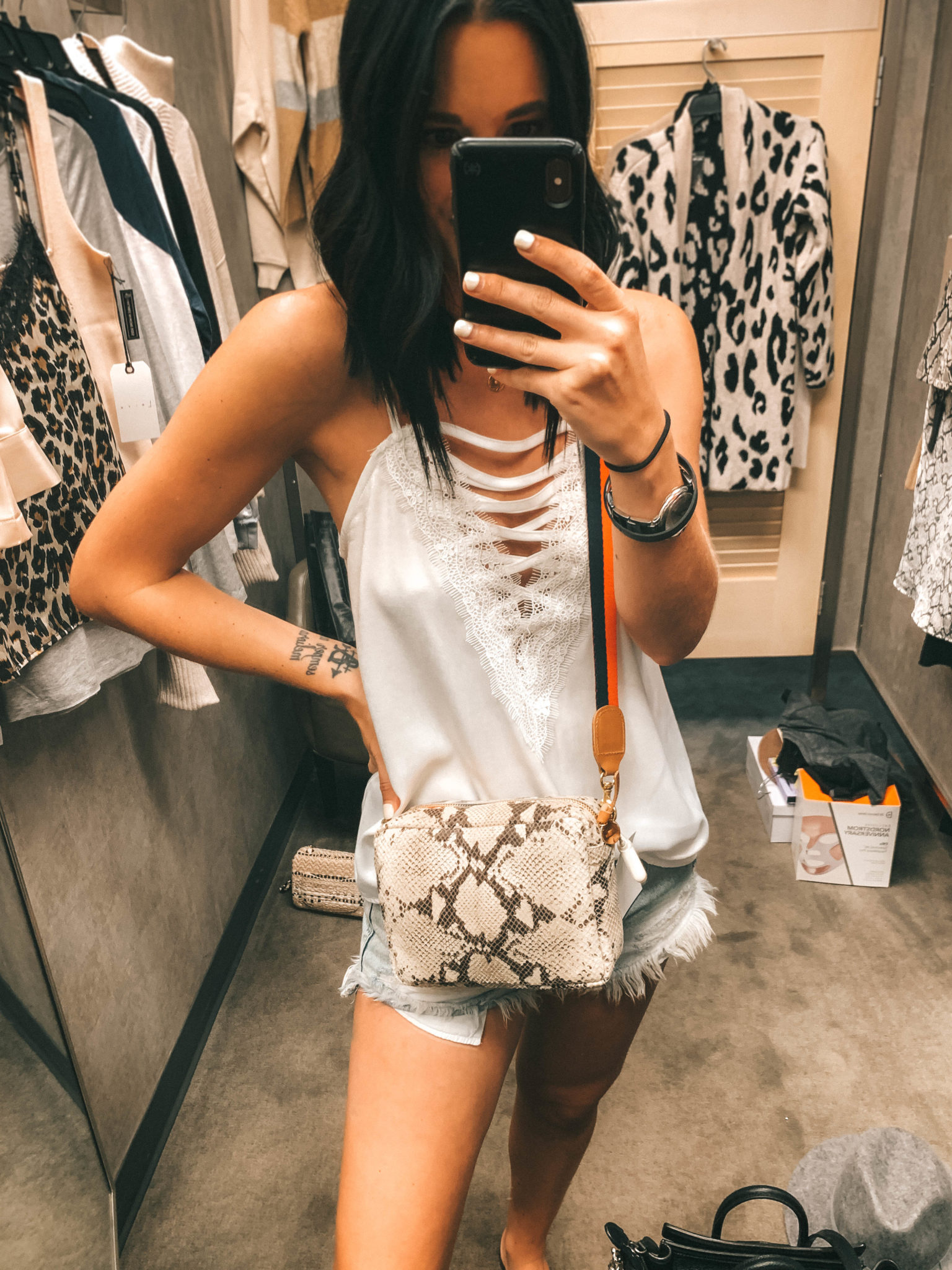 Top 11 Must Have Pieces from the Nordstrom Anniversary Sale by popular Austin fashion blog, Dressed to Kill: image of a woman standing in a Nordstrom Dressing room and wearing a Midi Sac Snakeskin Embossed Leather Crossbody Bag by CLARE V.