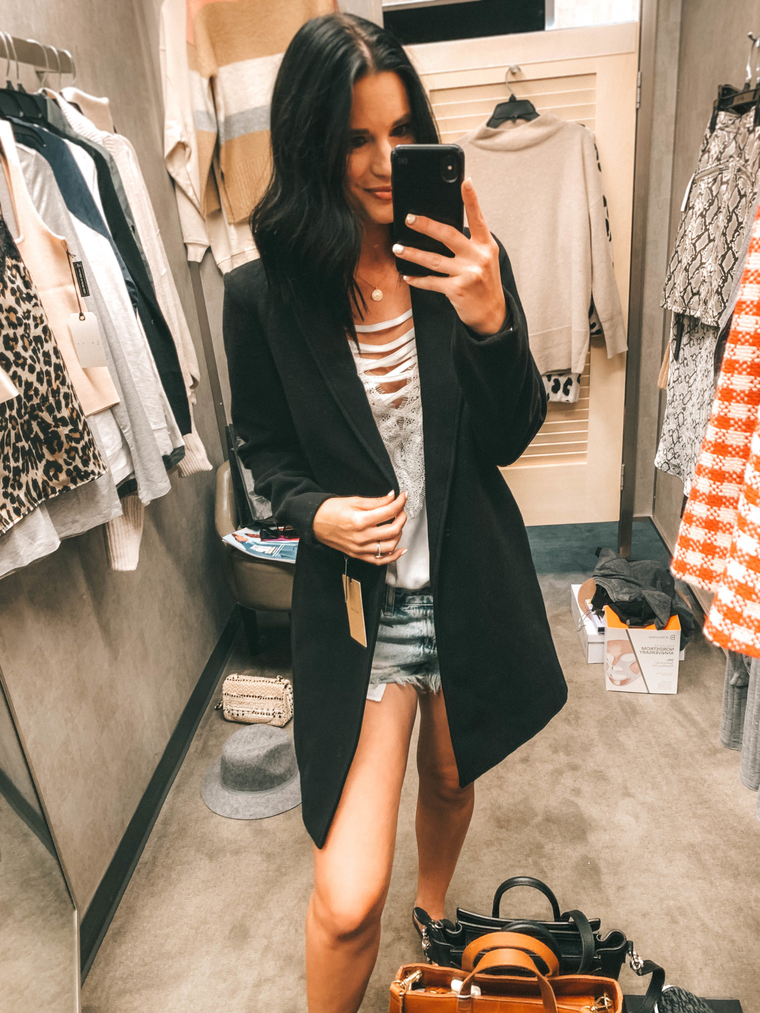 Top 11 Must Have Pieces from the Nordstrom Anniversary Sale by popular Austin fashion blog, Dressed to Kill: image of a woman in a Nordstrom dressing room wearing a black Halogen Black Blazer Coat.