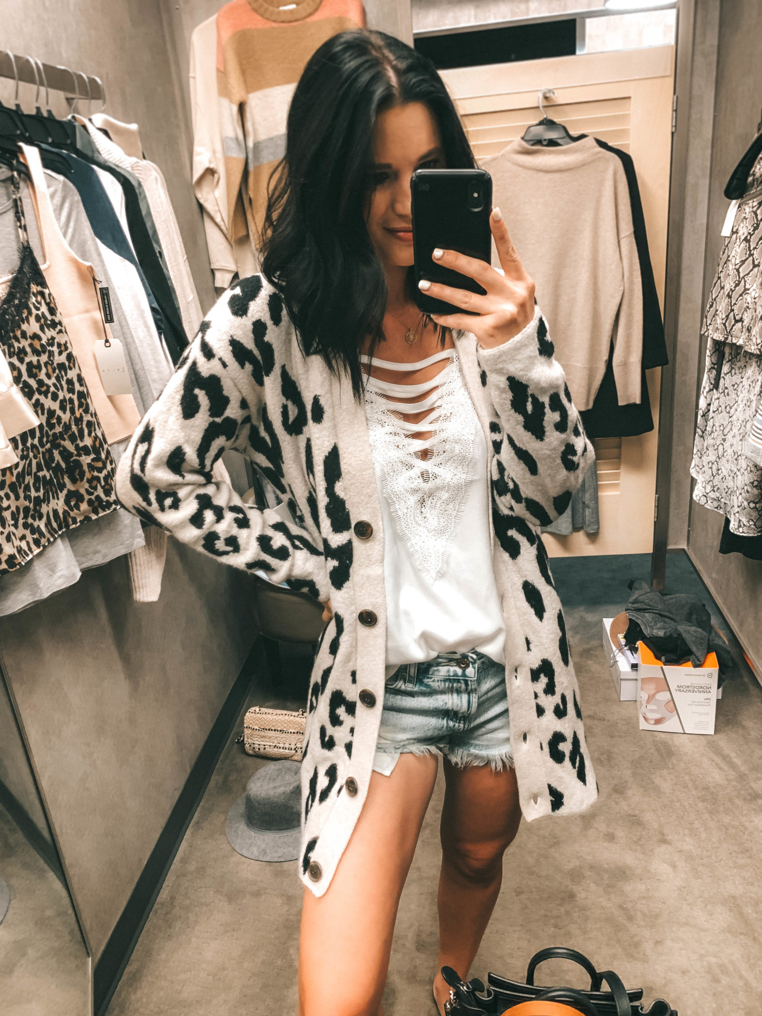 Top 11 Must Have Pieces from the Nordstrom Anniversary Sale by popular Austin fashion blog, Dressed to Kill: image of a woman in a Nordstrom dressing room wearing a Long Leopard Jacquard Cardigan by BP.
