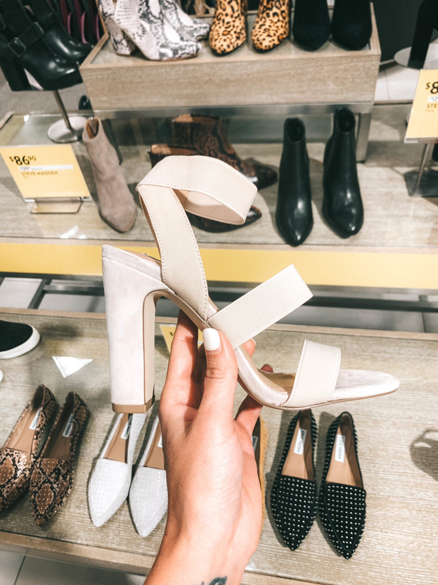 Top 11 Must Have Pieces from the Nordstrom Anniversary Sale by popular Austin fashion blog, Dressed to Kill: image of a woman holding a nude block heel sandal.