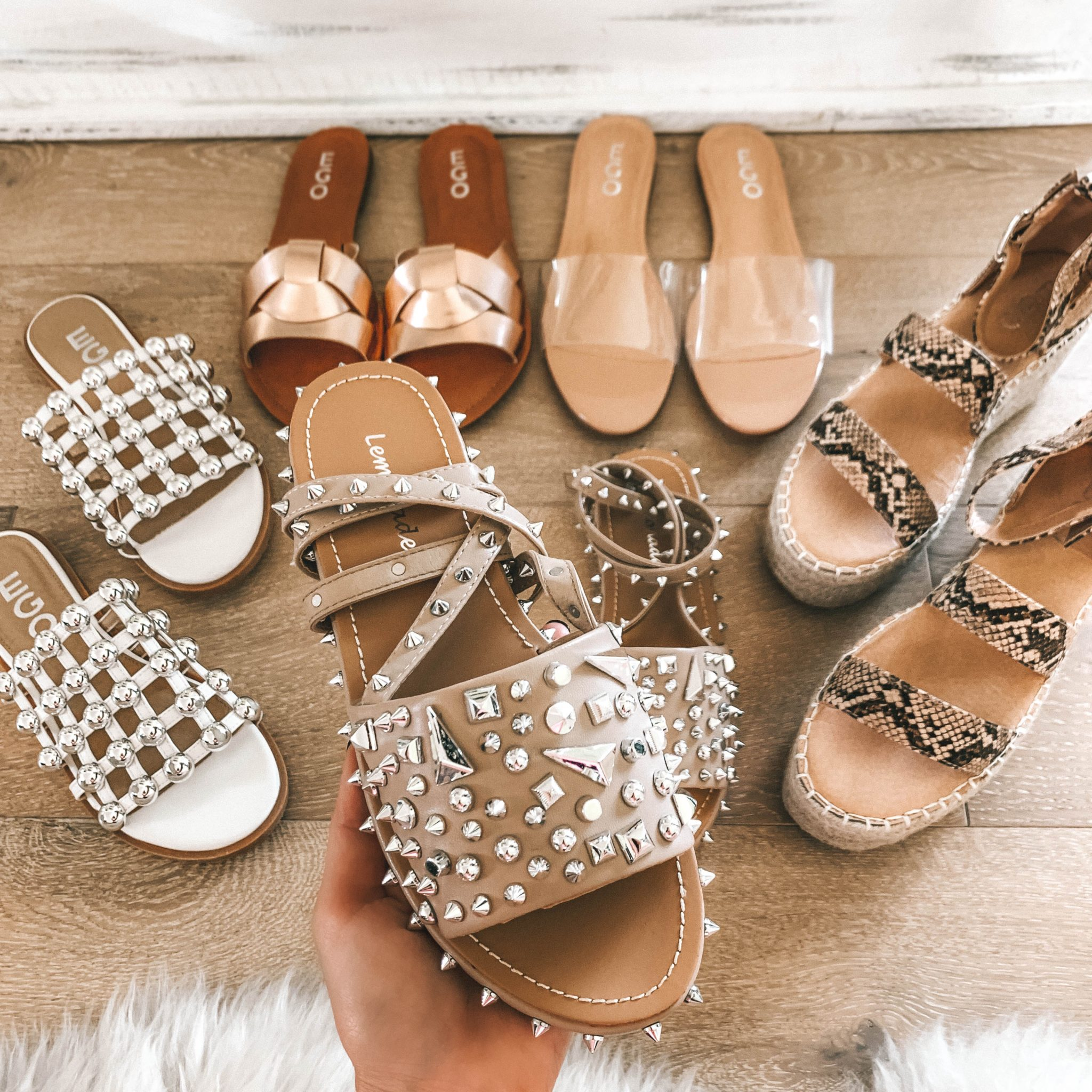 5 Must Have Affordable EGO Sandals for Summer by popular Austin fashion blog, Dressed to Kill: image of woman holding EGO sandals Alpha Lace Up Studded Detail Sandal In Nude Faux Leather.