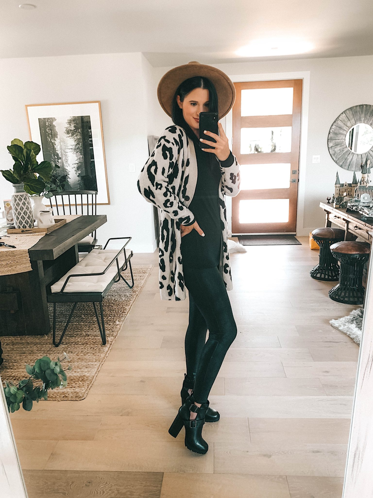 Create a Capsule Wardrobe with Nordstrom Anniversary Sale Pieces by popular Austin fashion blog, Dressed to Kill: image of a woman standing in her house and wearing Nordstrom Steve Madden Black Booties