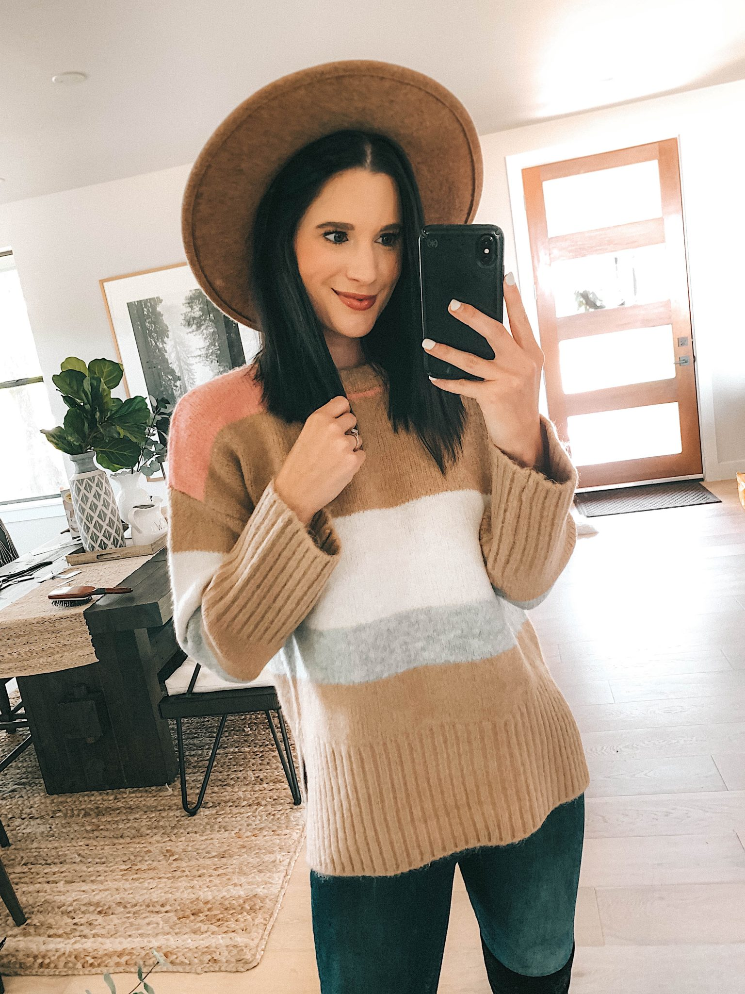 Create a Capsule Wardrobe with Nordstrom Anniversary Sale Pieces by popular Austin fashion blog, Dressed to Kill: image of a woman standing in her house and wearing a Nordstrom Topshop color block sweater.