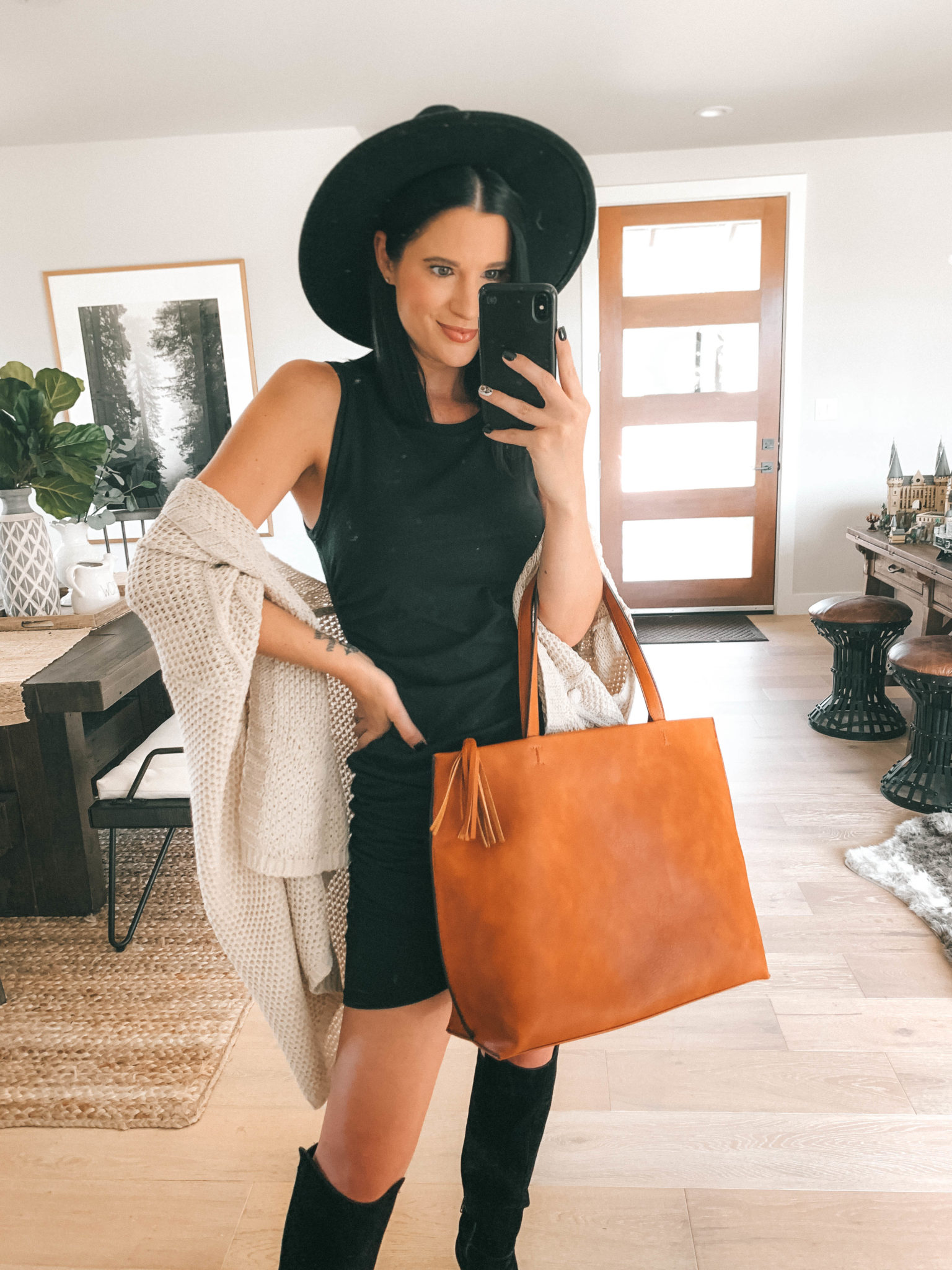 Must Have Sole Society Fall Staples by popular Austin fashion blog, Dressed to Kill: image of a woman wearing a black Nordstrom Leith rouched body-con dress, Sole Society Paloma wedge boot, Sole Society Knit Detail Wrap, and holding a Sole Society Wallis Tote.