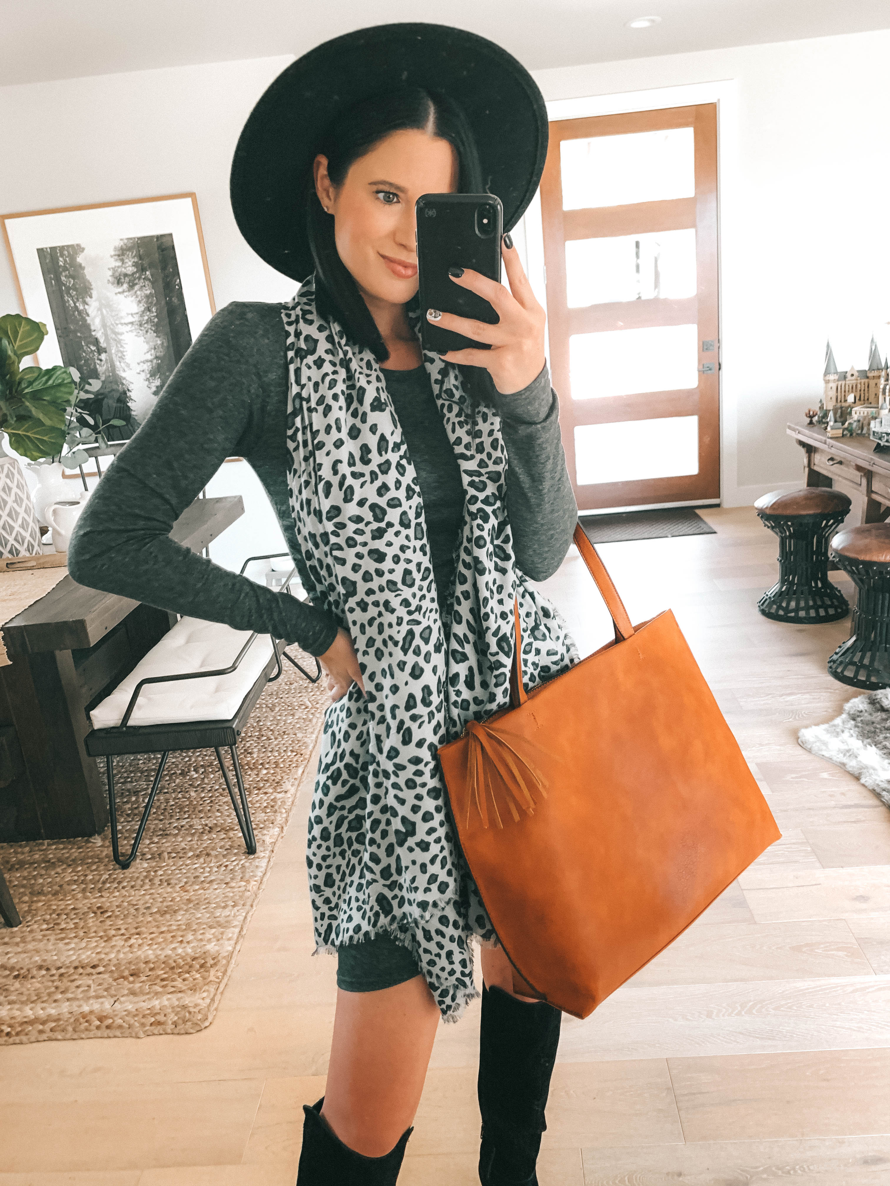 Must Have Sole Society Fall Staples by popular Austin fashion blog, Dressed to Kill: image of a woman wearing a grey rouched body-con dress, Sole Society Paloma Wedge Boots, leopard print oversized scarf, and holding a Wallis Tote.