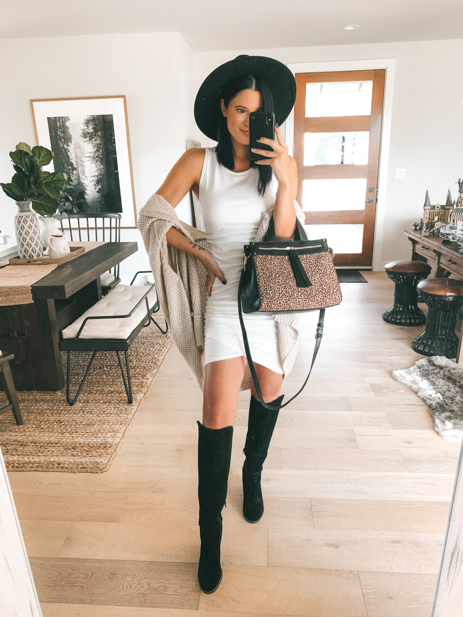 Must Have Sole Society Fall Staples by popular Austin fashion blog, Dressed to Kill: image of a woman wearing a Nordstrom Leith rouched body-con dress, Sole Society Paloma wedge boot, Sole Society Knit Detail Wrap, and holding a Sole Society leopard print Zypa Satchel.