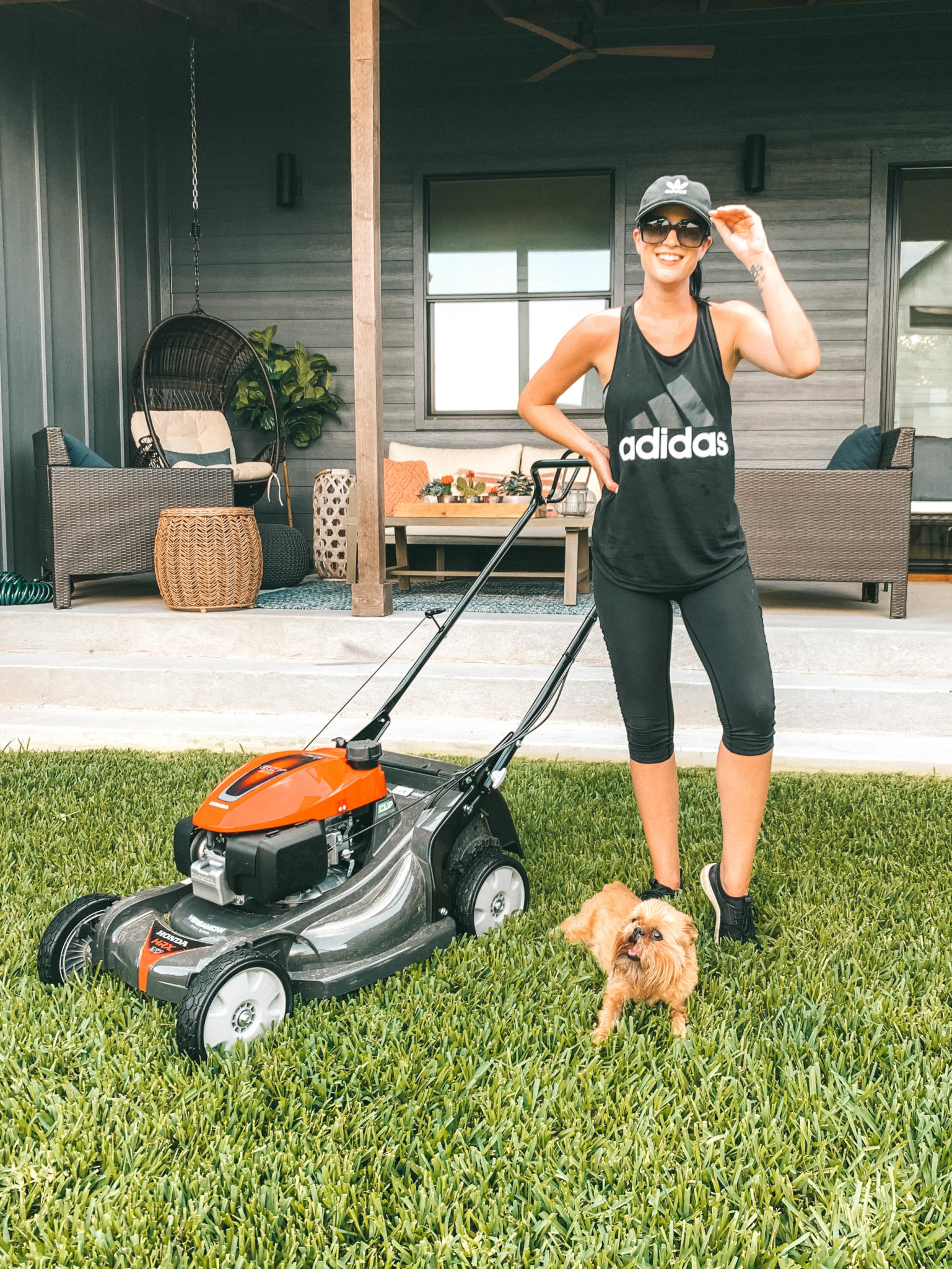 Honda Miimo Robotic Lawn Mower Review | If you're like me and love to mow the lawn, this robotic lawn mower will change the way you do lawn care! || Dressed to Kill #roboticlawnmower #lawnmower #lawncare | Honda Miimo Robotic Lawn Mower Review by popular Austin lifestyle blog, Dressed to Kill: image of woman standing next to her Honda HRX217HYA lawn mower.