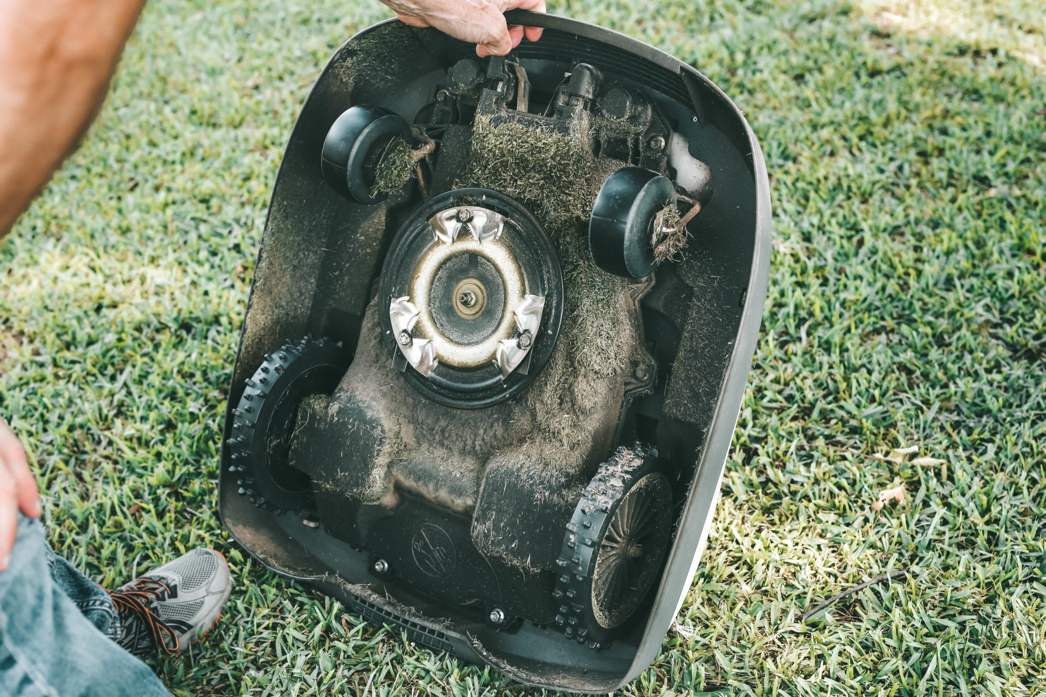 Honda Miimo Robotic Lawn Mower Review by popular Austin lifestyle blog, Dressed to Kill: image of the underside of a Honda Miimo Robotic Lawn Mower.