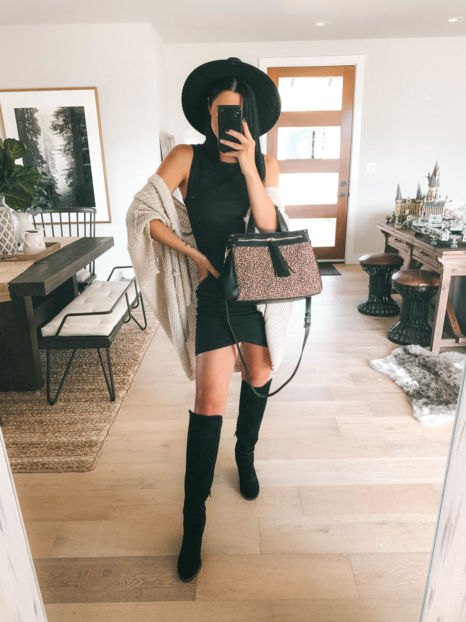 Must Have Sole Society Fall Staples by popular Austin fashion blog, Dressed to Kill: image of a woman wearing a black Nordstrom Leith rouched body-con dress, Sole Society Paloma wedge boot, Sole Society Knit Detail Wrap, and holding a Sole Society leopard print Zypa Satchel.
