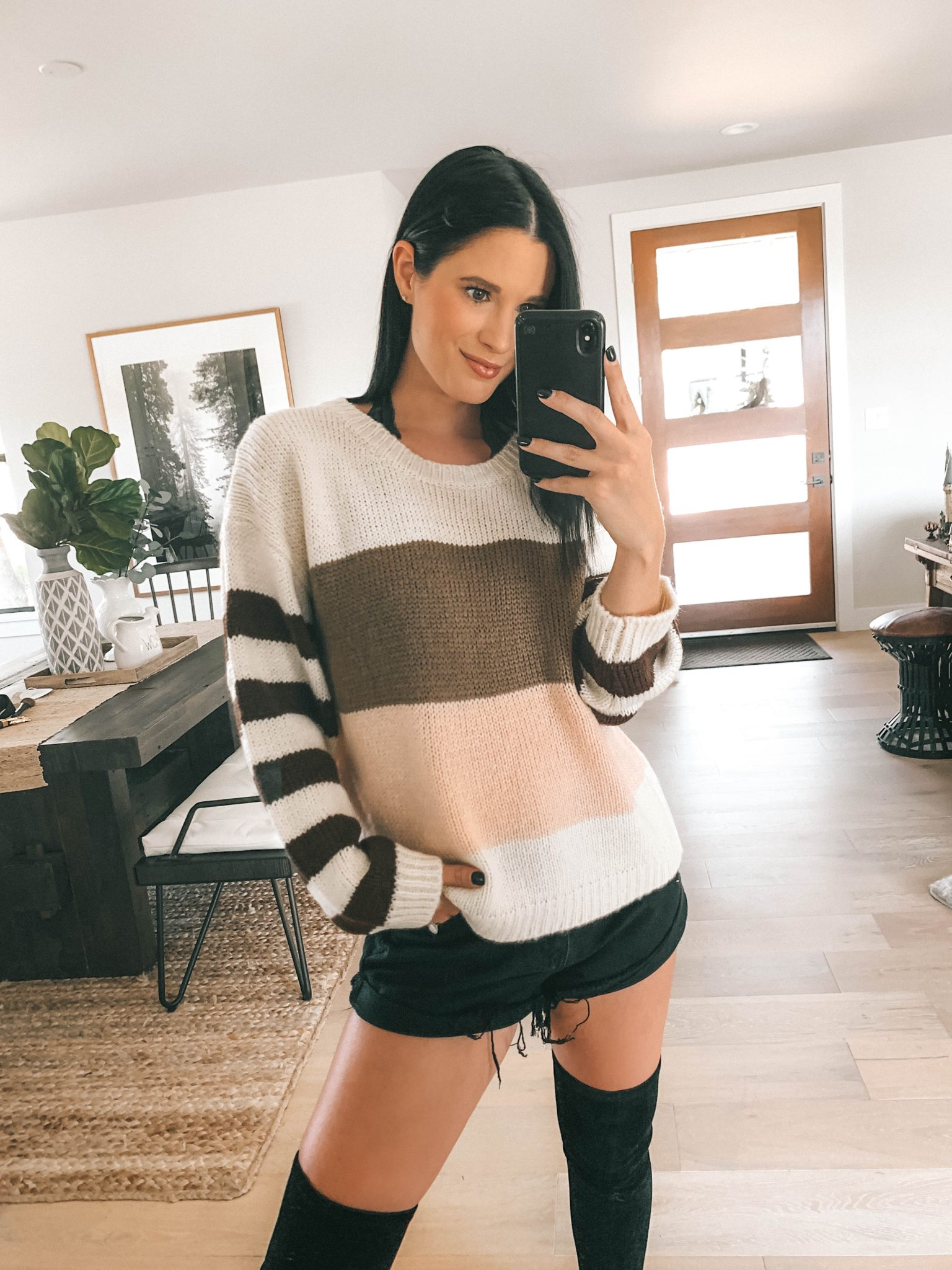 Transition Your Summer Looks Into Fall with Princess Polly Clothing by popular Austin fashion blog, Dressed to Kill: image of a woman wearing a Princess Polly black Eddie Highwaisted shorts and a multi-color stripe sweater.