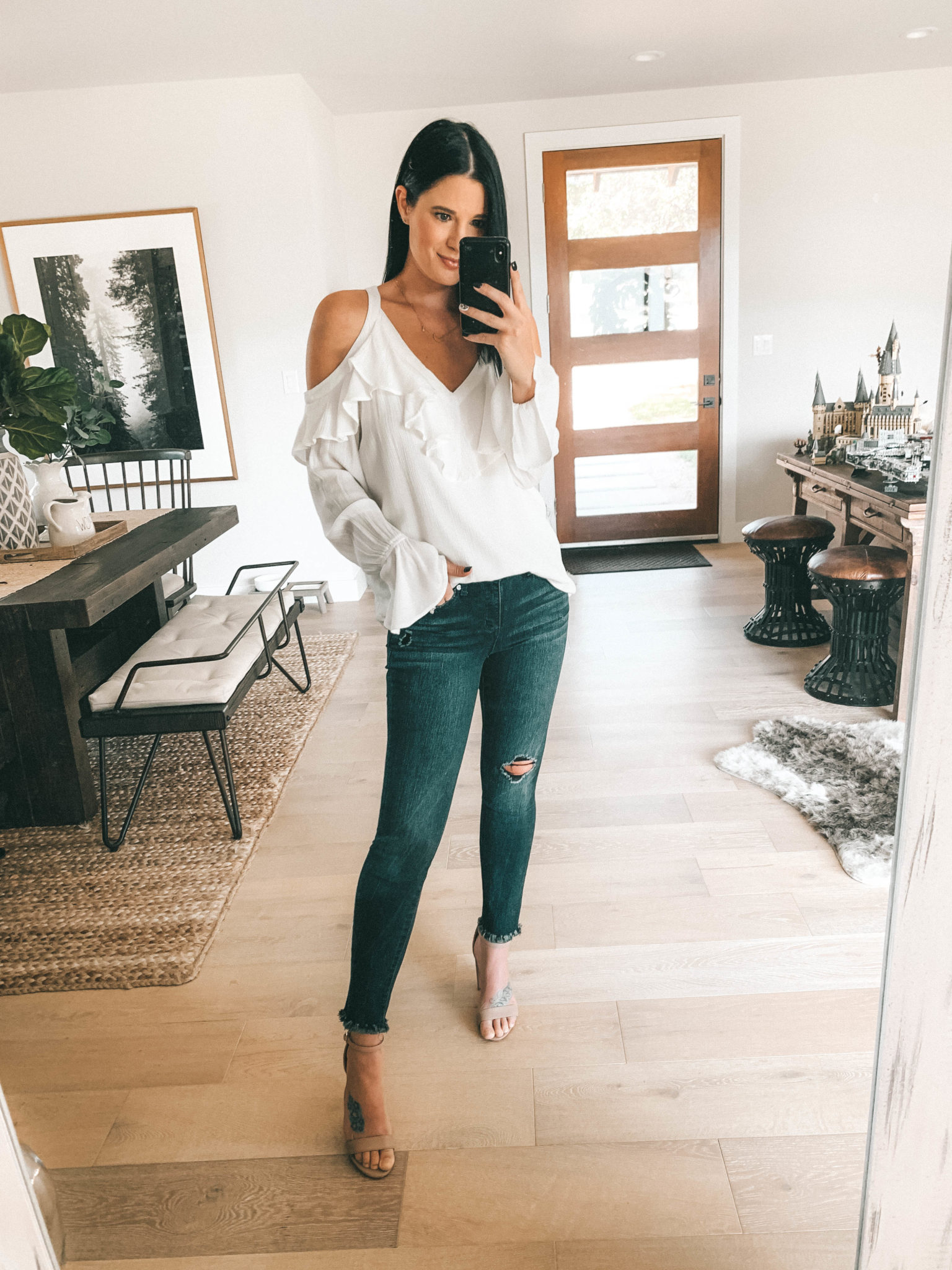 7 Affordable Fall Outfits from Walmart by popular Austin fashion blog, Dressed to Kill: image of a woman standing inside her house and wearing Sofia Jeans Cold-Shoulder Ruffle Neck Woven Top and Sofia Jeans Sofia Skinny Destructed Frayed Hem Mid Rise Ankle Jean.