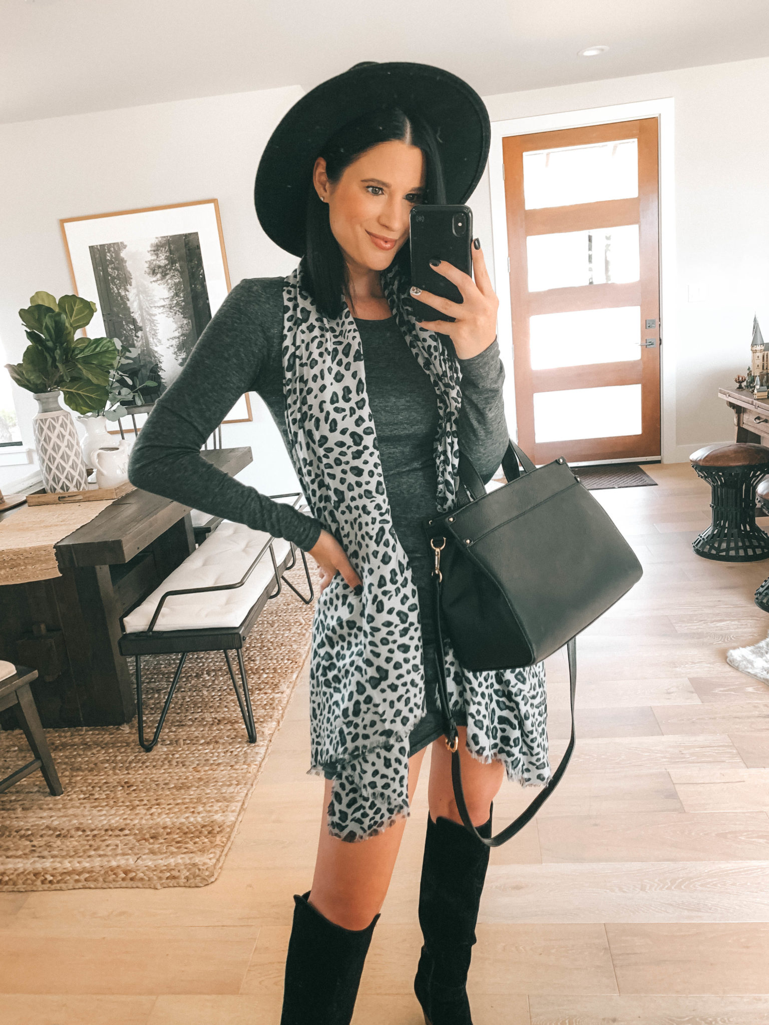 Must Have Sole Society Fall Staples by popular Austin fashion blog, Dressed to Kill: image of a woman wearing a grey rouched body-con dress, Sole Society Paloma Wedge Boots, leopard print oversized scarf, and holding a black Zypa Satchel.