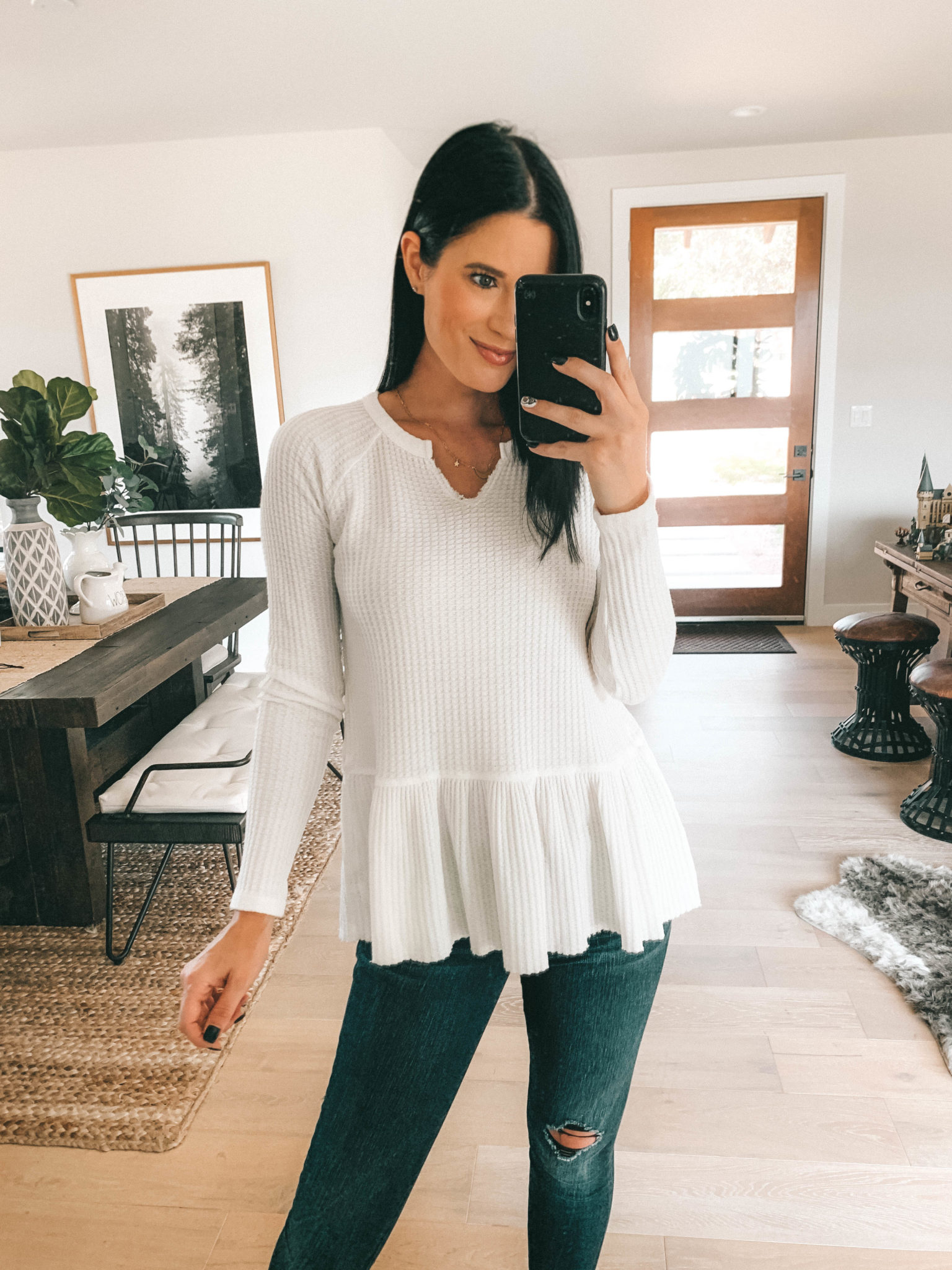 7 Affordable Fall Outfits from Walmart by popular Austin fashion blog, Dressed to Kill: image of a woman standing inside her house and wearing a white Walmart Time and Tru Women's Thermal Peplum.