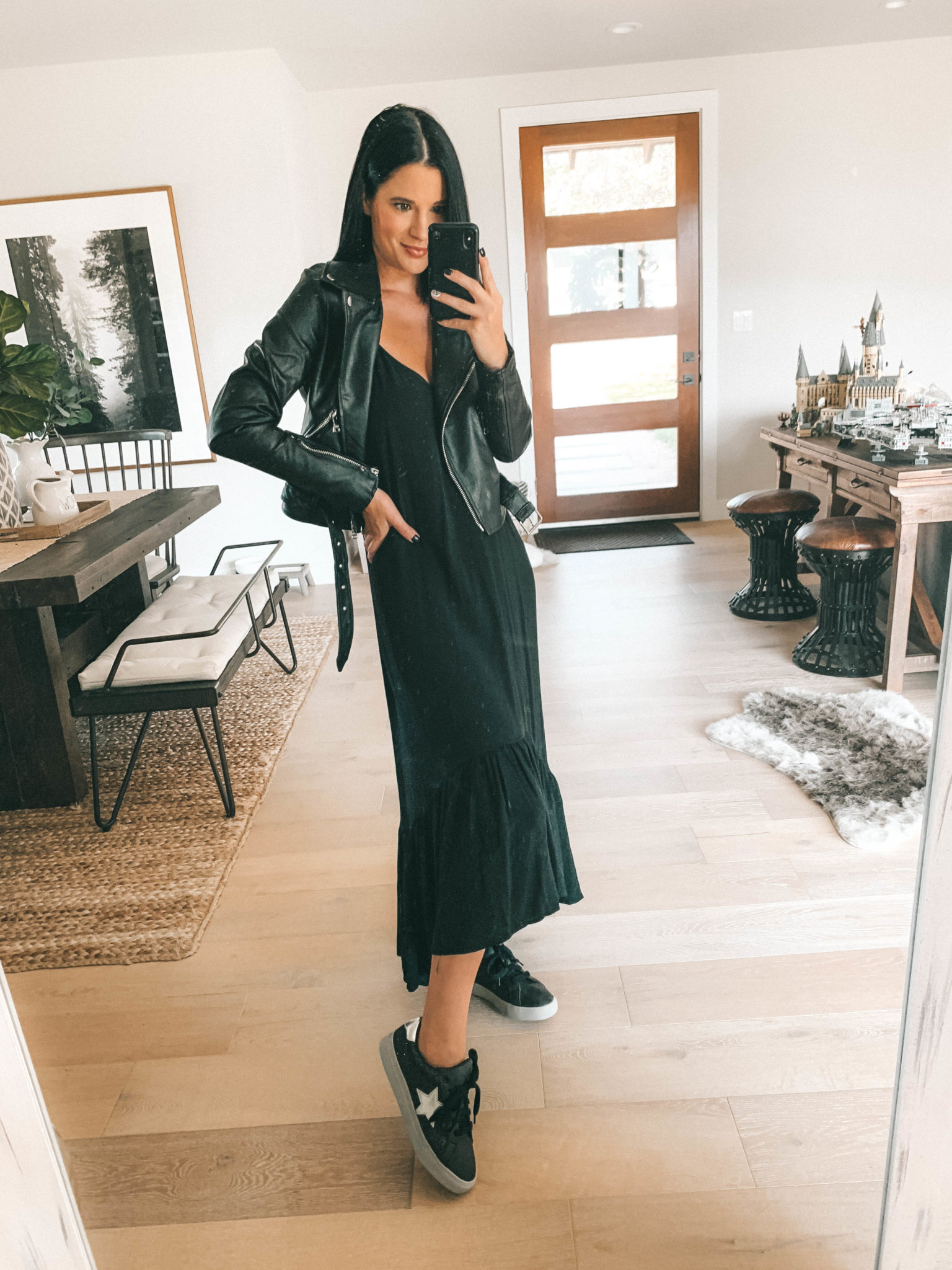 7 Affordable Fall Outfits from Walmart by popular Austin fashion blog, Dressed to Kill: image of a woman standing inside her house and wearing a black Walmart Love Sadie Women's Ruffle Maxi Dress