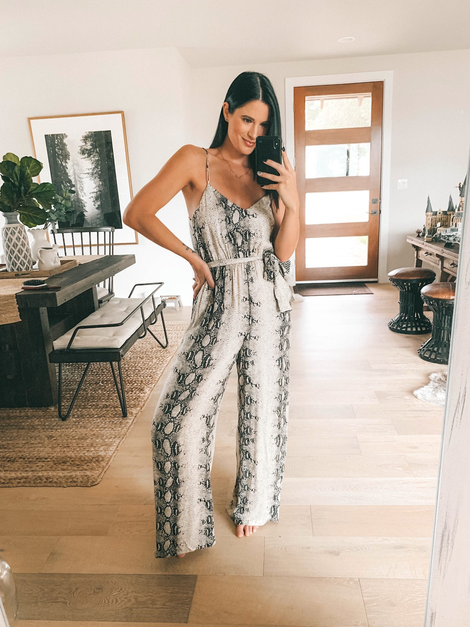 Lovestitch Fall Outfit Try-On Session by popular Austin fashion blog, Dressed to Kill: image of a woman wearing a Lovestitch Laras Snakeskin Print Jumpsuit.