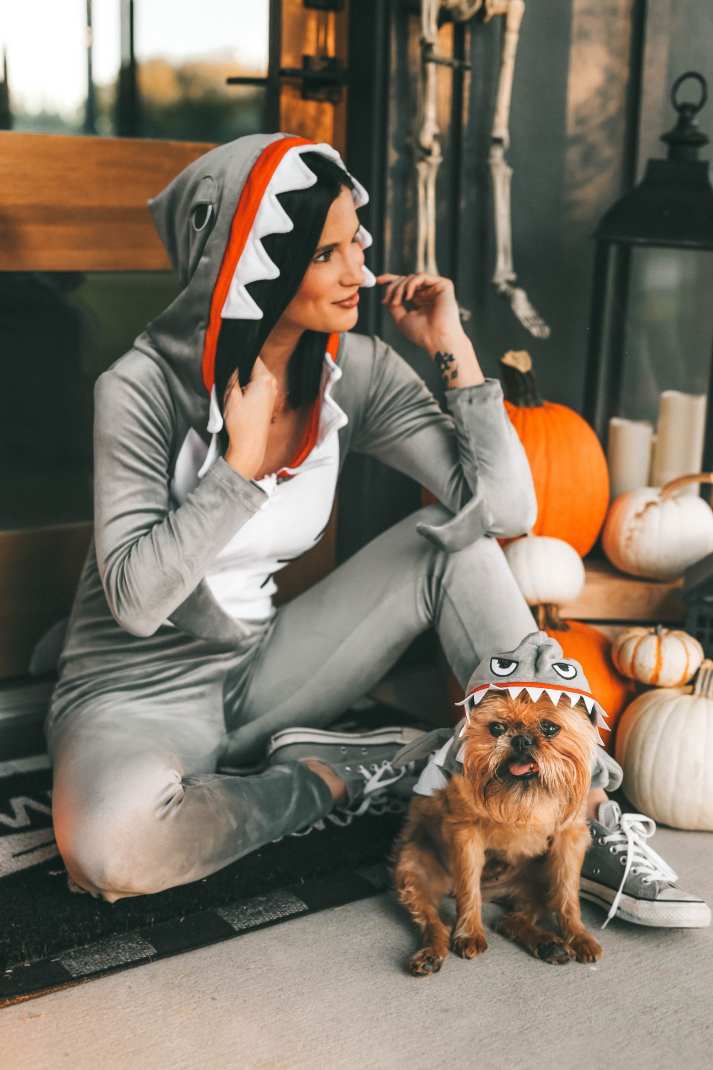 My Favorite Matching Dog and Owner Halloween Costumes by popular Austin lifestyle blog, Dressed to Kill: image of woman outside wearing an Amazon Fun Costumes Womens Sassy Shark Costume and Nordstrom Converse Chuck Taylor® All Star® 70 Always On Low Top Sneaker and holding her dog who is wearing a Chewy Frisco Great White Shark Dog & Cat Costume.