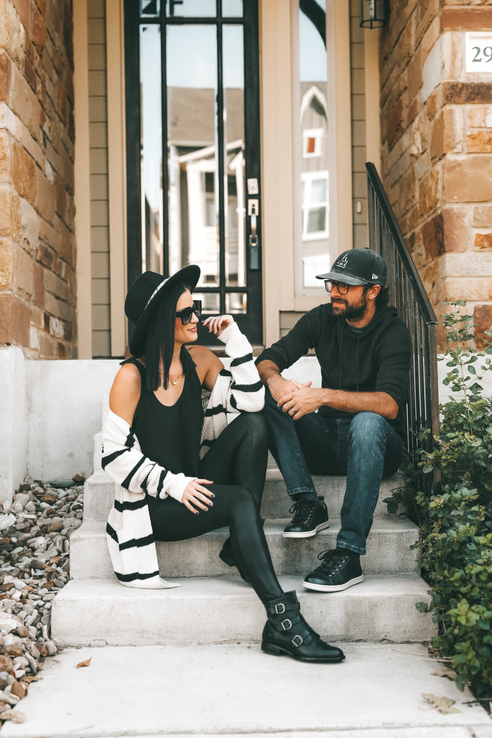 Must Have Cute Fall Shoes for Him & Her by popular Austin fashion blog, Dressed to Kill: image of a man and woman wearing Zappos Born Nivine ankle boots and Zappos Born Allegheny sneakers.