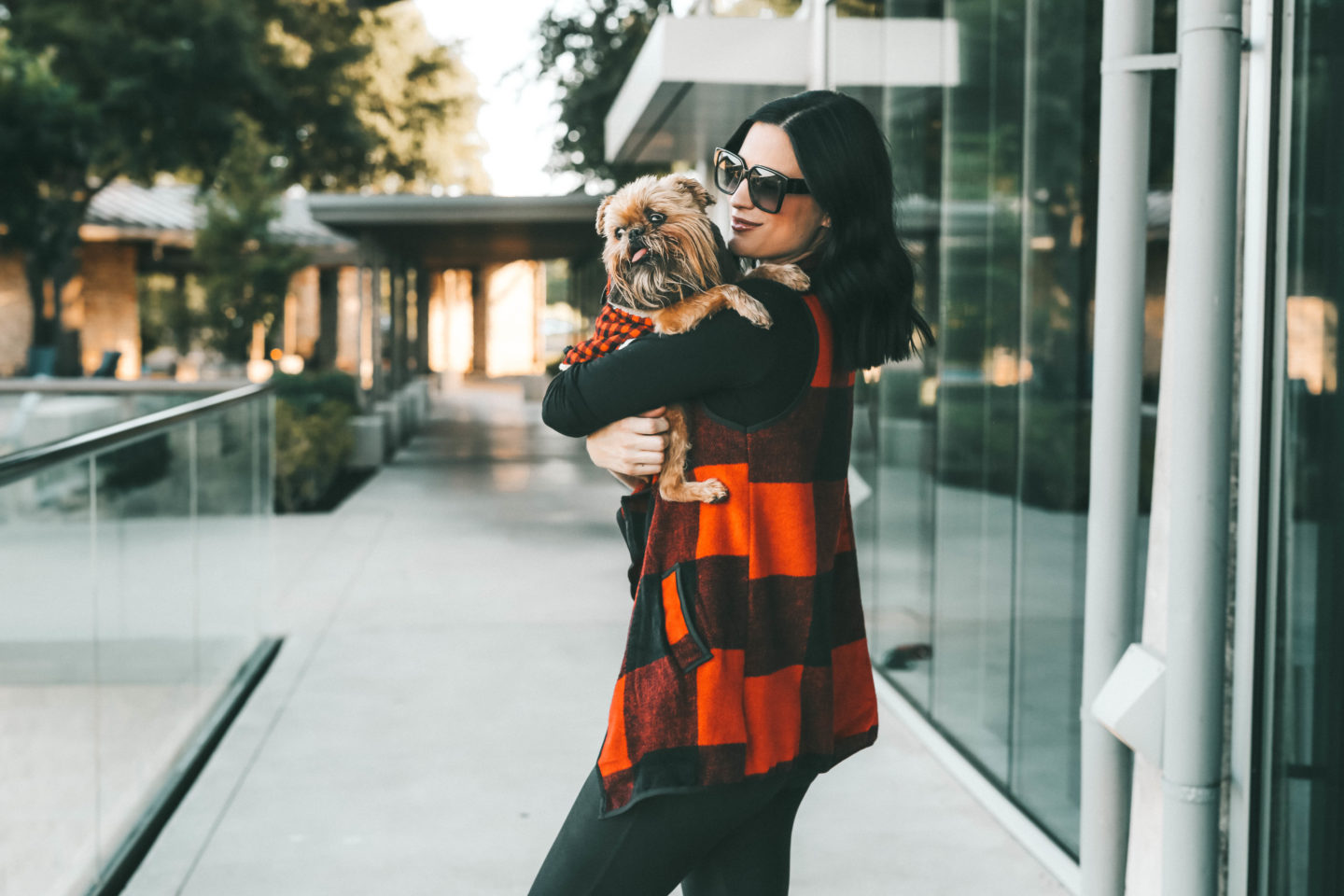 Matching Dog and Owner Outfits for the Holidays by popular Austin life and style blog, Dressed to Kill: image of an owner and her dog wearing an Amazon KIRJAUDU Womens Lapel Open Front Sleeveless Plaid Vest Cardigan with Pockets, Nordstrom Halogen Long Sleeve Modal Blend Tee, Nordstrom Spanx Faux Leather Leggings, Amazon GLOBALWIN Women's 1632 Black Grey Snow Boots, Bare Necessities BAREFOOT DREAMS COZYCHIC HEATHERED PLUSH SOCKS, and Chewy plaid sweater.