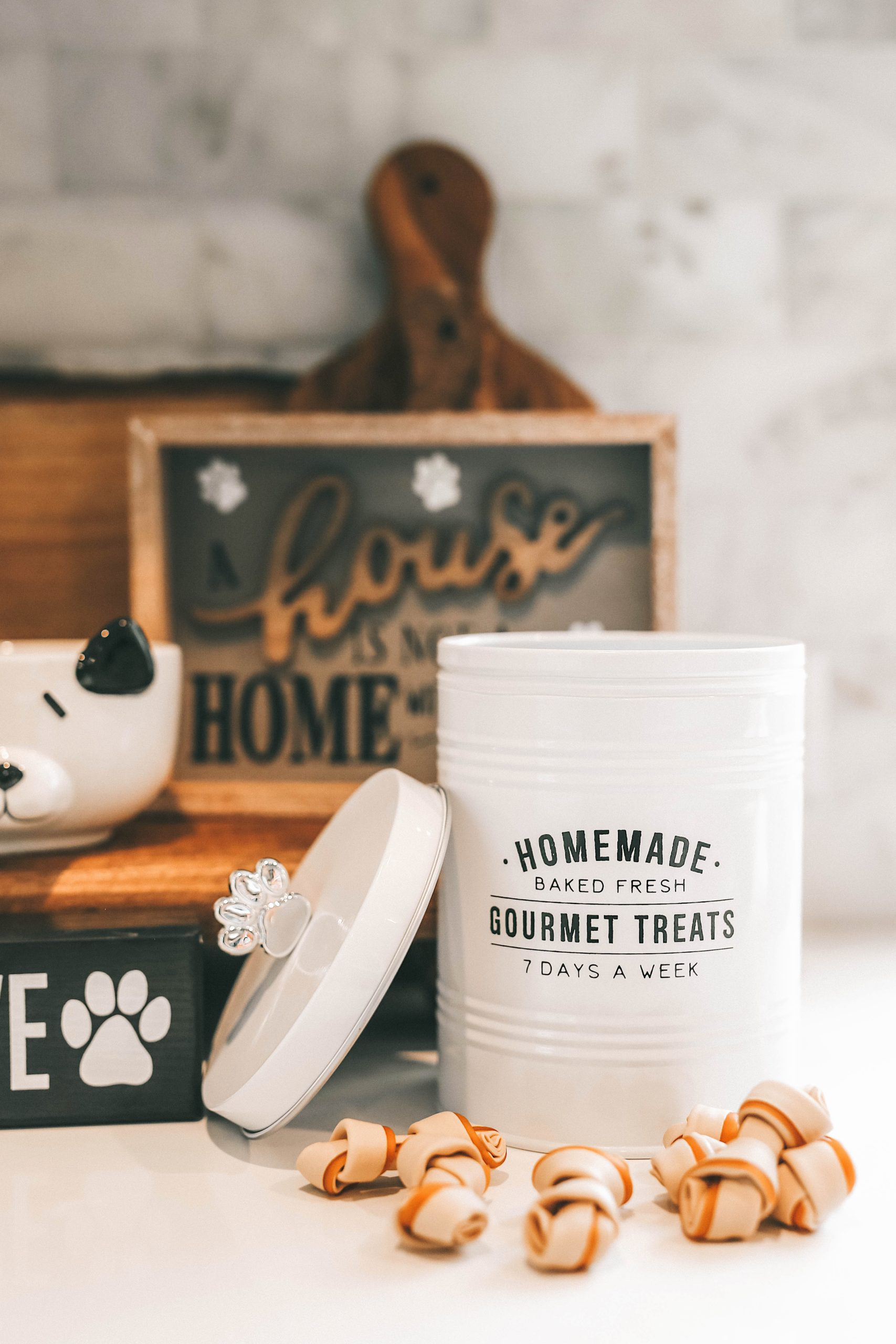 How to Pamper Your Pet by popular Nashville life and style blog, Dressed to Kill: image of various dog decor signs and a dog treat canister from Tuesday Morning.