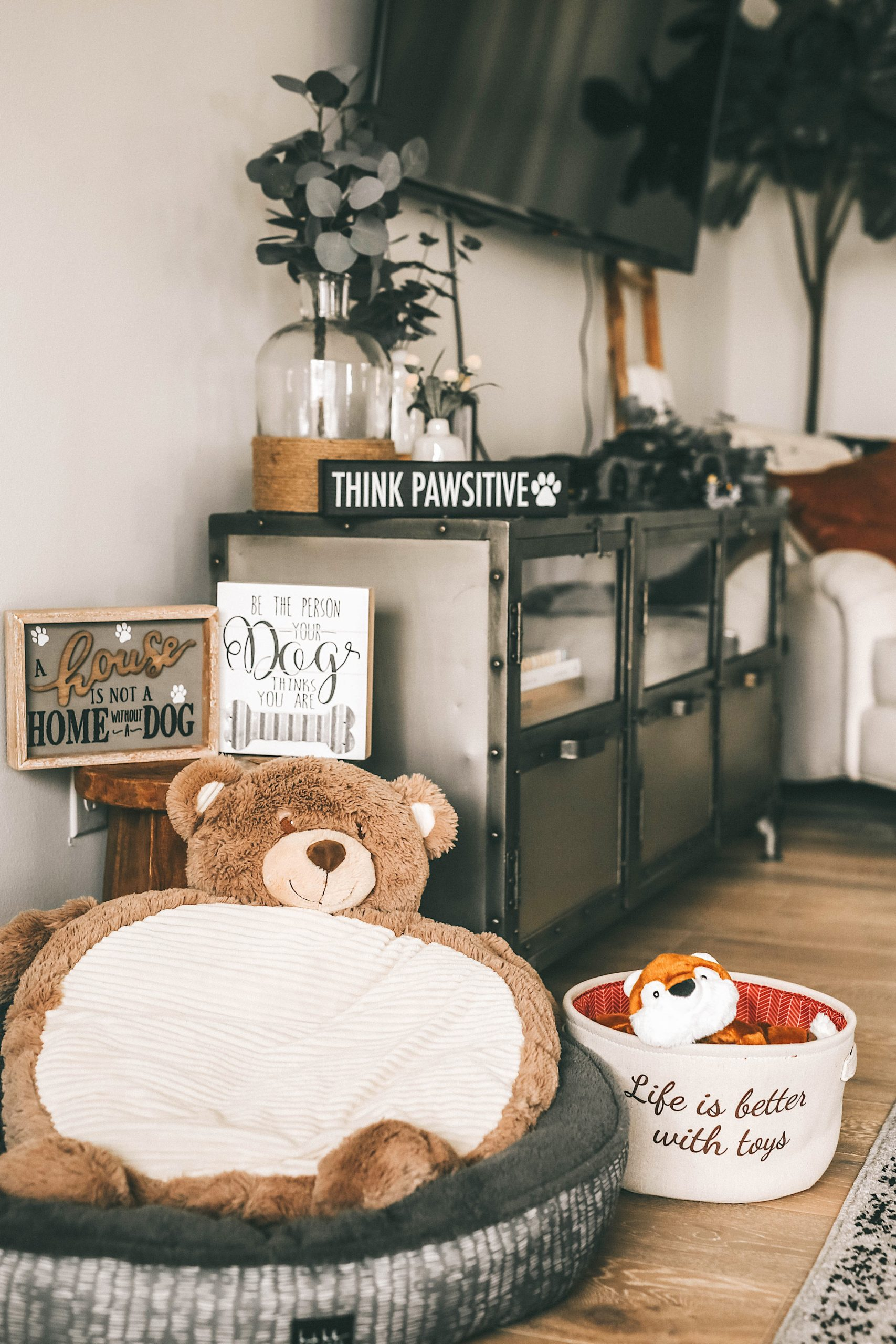 How to Pamper Your Pet by popular Nashville life and style blog, Dressed to Kill: image of a bear shaped dog bed, a grey dog bed, a fabric toy basket, a tiger toy, and various dog signs from Tuesday Morning.