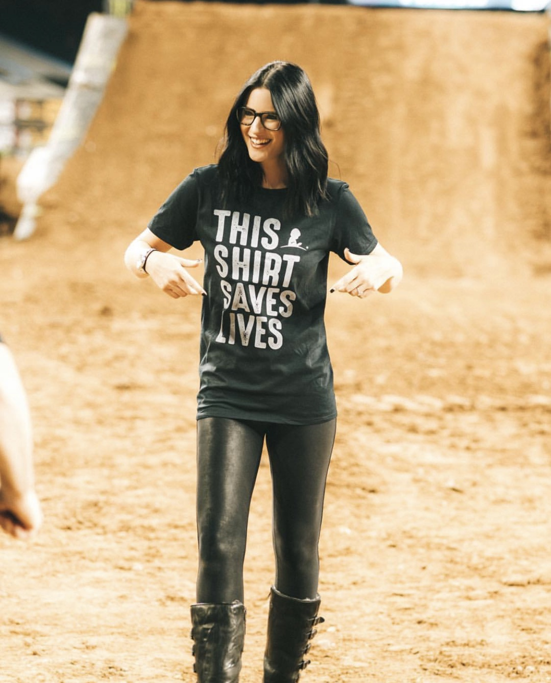 This Shirt Saves Lives by popular Austin lifestyle blog, Dressed to Kill: image of a woman wearing a St. Jude's This Shirt Saves Lives t-shirt and at a supercross venue.