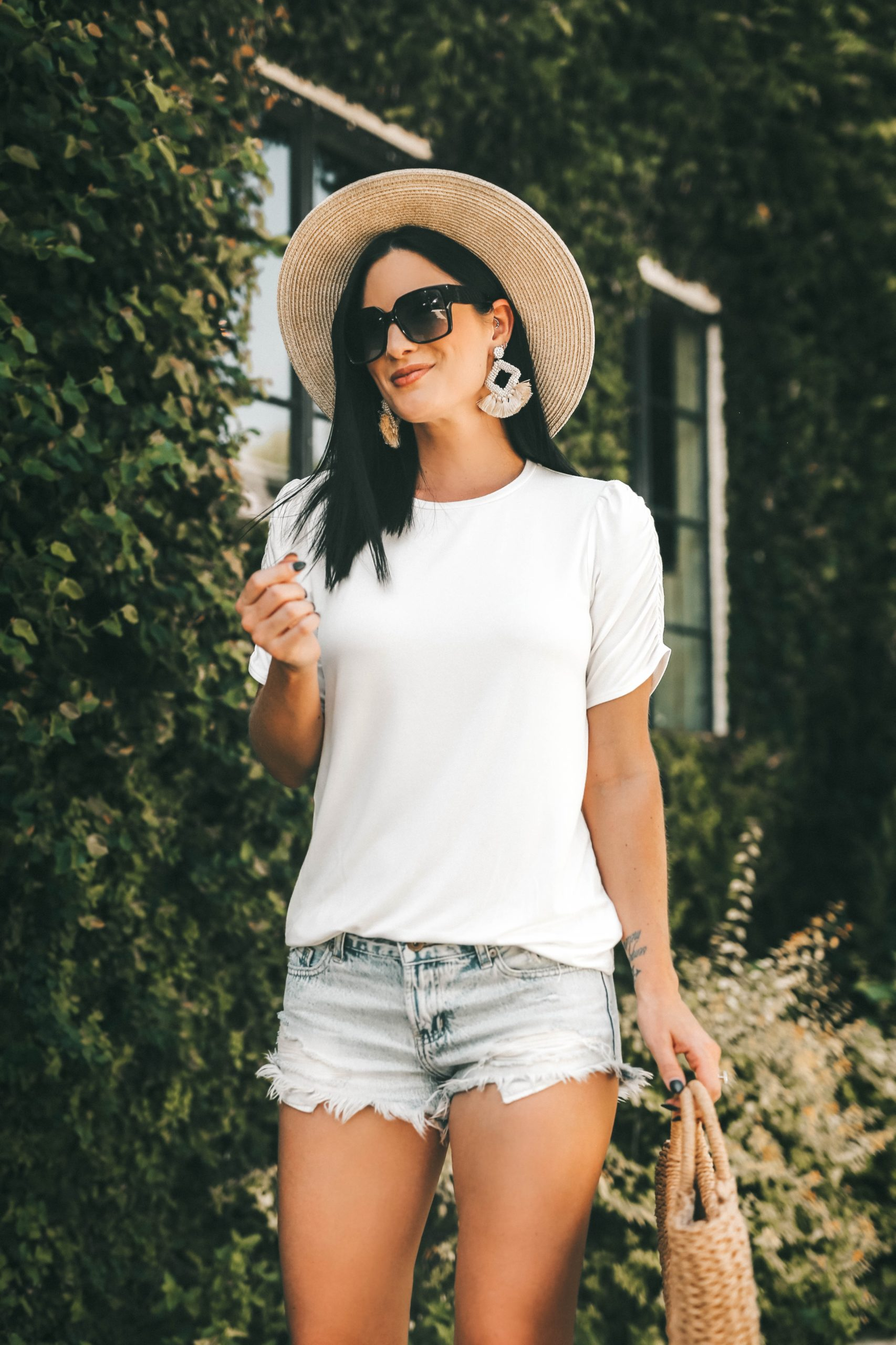 Gibson Look Road Trip by popular Austin fashion blog, Dressed to Kill: image of a woman wearing a DTK Austin Gibson Look Road Trip puff sleeve shirt and denim cut off shorts.